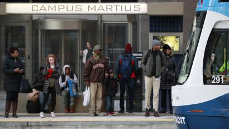 passengers wait on the QLINE transit train in Detroit