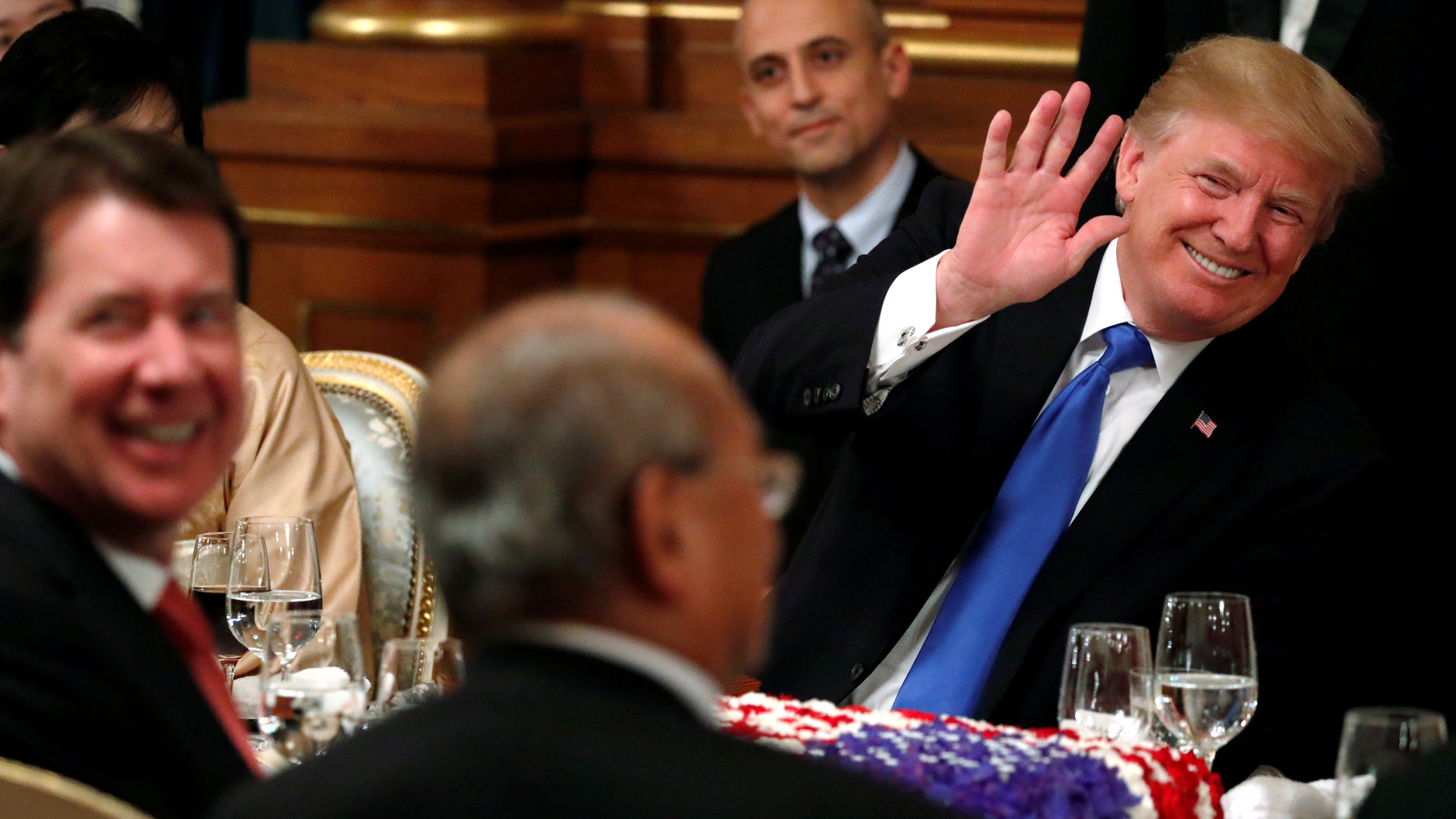 U.S. President Donald Trump waves to an attendee at an official dinner for thrown in his honor by Japan's Prime Minister Shinzo Abe at Akasaka Palace in Tokyo, Japan November 6, 2017.