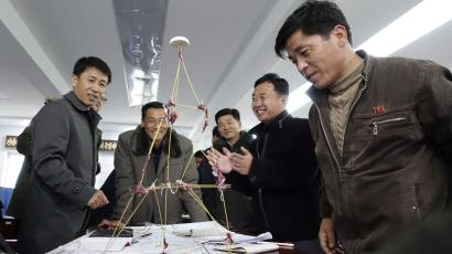 Choson Exchange participants finish a team-building construction exercise
