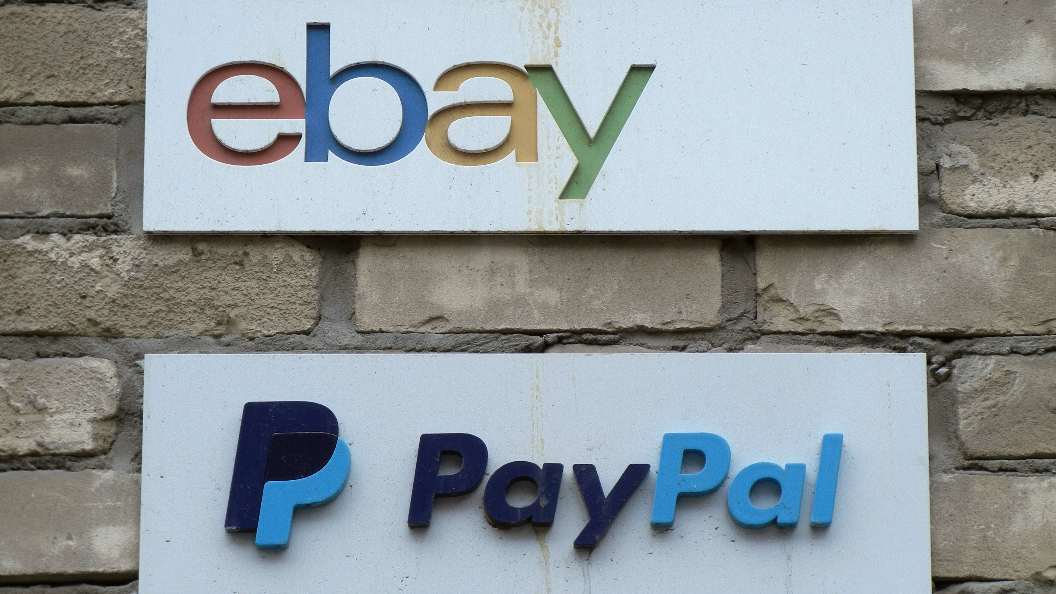 Signs are posted outside the offices of online marketplace eBay and its electronic payments division PayPal in Toronto April 5, 2015.