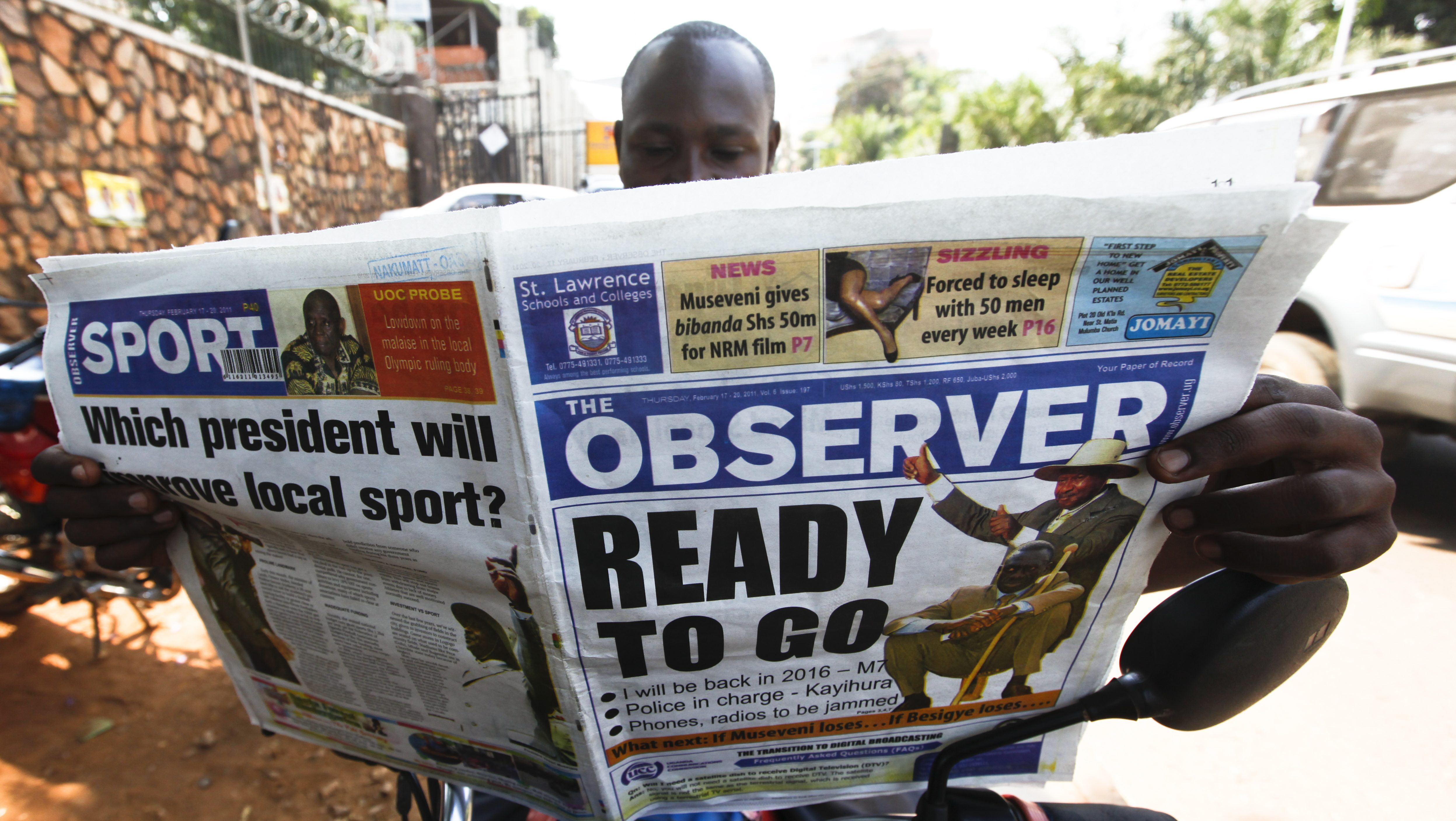 A 'boda boda' driver reads a newspaper featuring a presidential election article on its front page in downtown Kampala, Uganda, 17 February 2011, a day before the voting day. The leader of National Resistance Movement (NRM), President Yoweri Museveni, who is widely expected to win the poll, has dismissed the possibility of an Egypt-inspired revolution in his country, responding to threats made by his main opponent Kizza Besigye, the leader of the main opposition Forum for Democratic Change (FDC). Museveni said the government will arrest those who try to incite protests. Besigye, who is challenging Museveni for the third time, is considered to be the only one to pose the real challenge to the incumbent. 13.8 million Ugandans will vote on 18 February to choose their president.