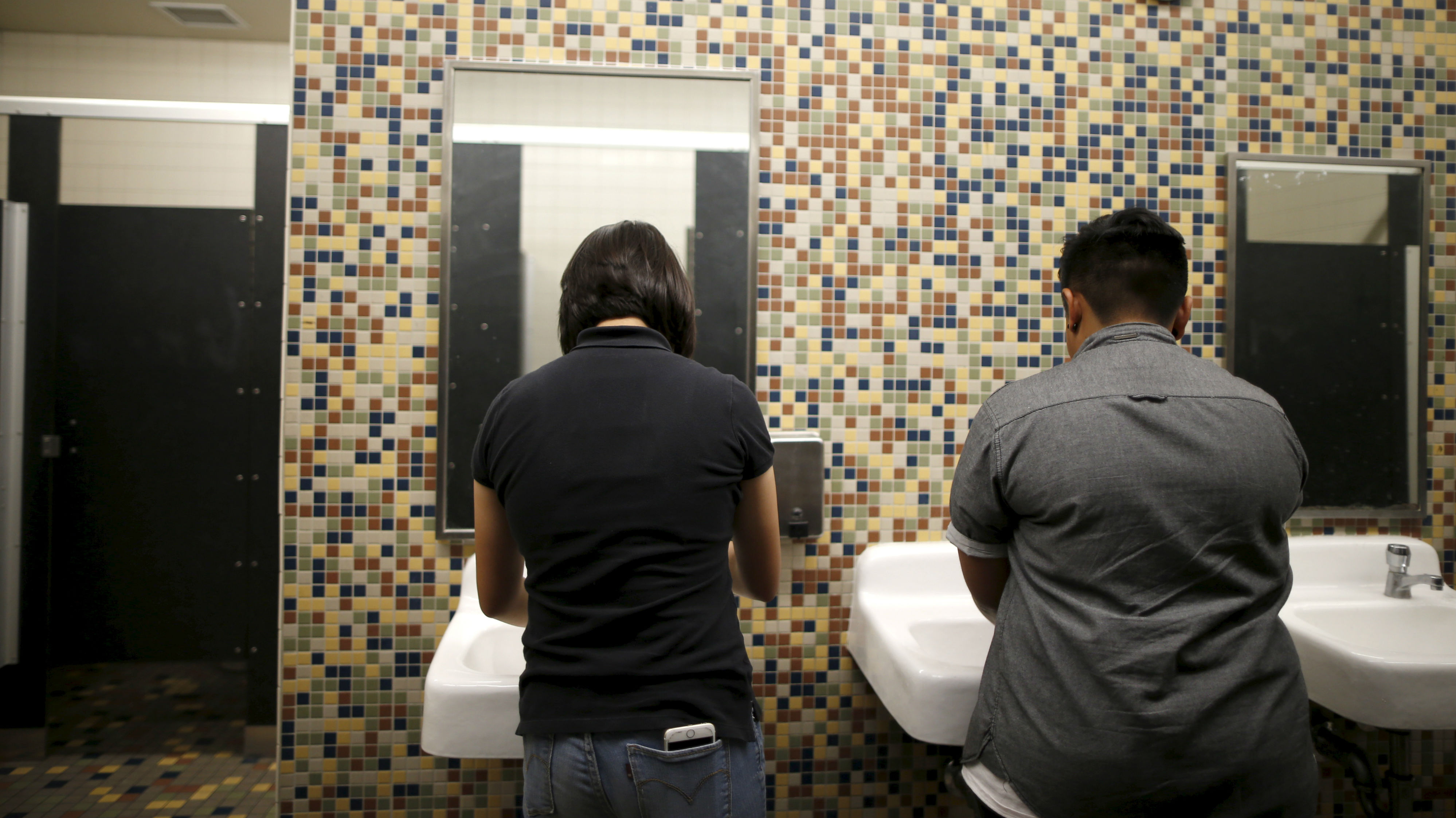 Students wash their hands in the first gender-neutral restroom in the Los Angeles school district at Santee Education Complex high school in Los Angeles, California, U.S., April 18, 2016.