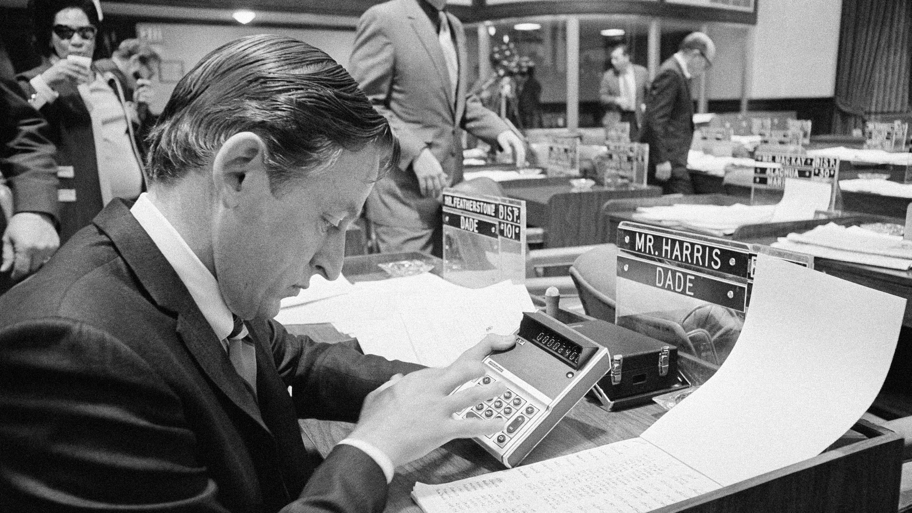 Dade County Rep. Marshall Harris, D-Miami, Fla., uses a small electronic calculator as he computes figures during discussion on the house floor on proposed insurance legislation in Tallahassee, Florida  Jan. 28, 1971. The Florida lawmakers are in the state capitol for a special session, dealing with insurance matters and taxes. (AP Photo)