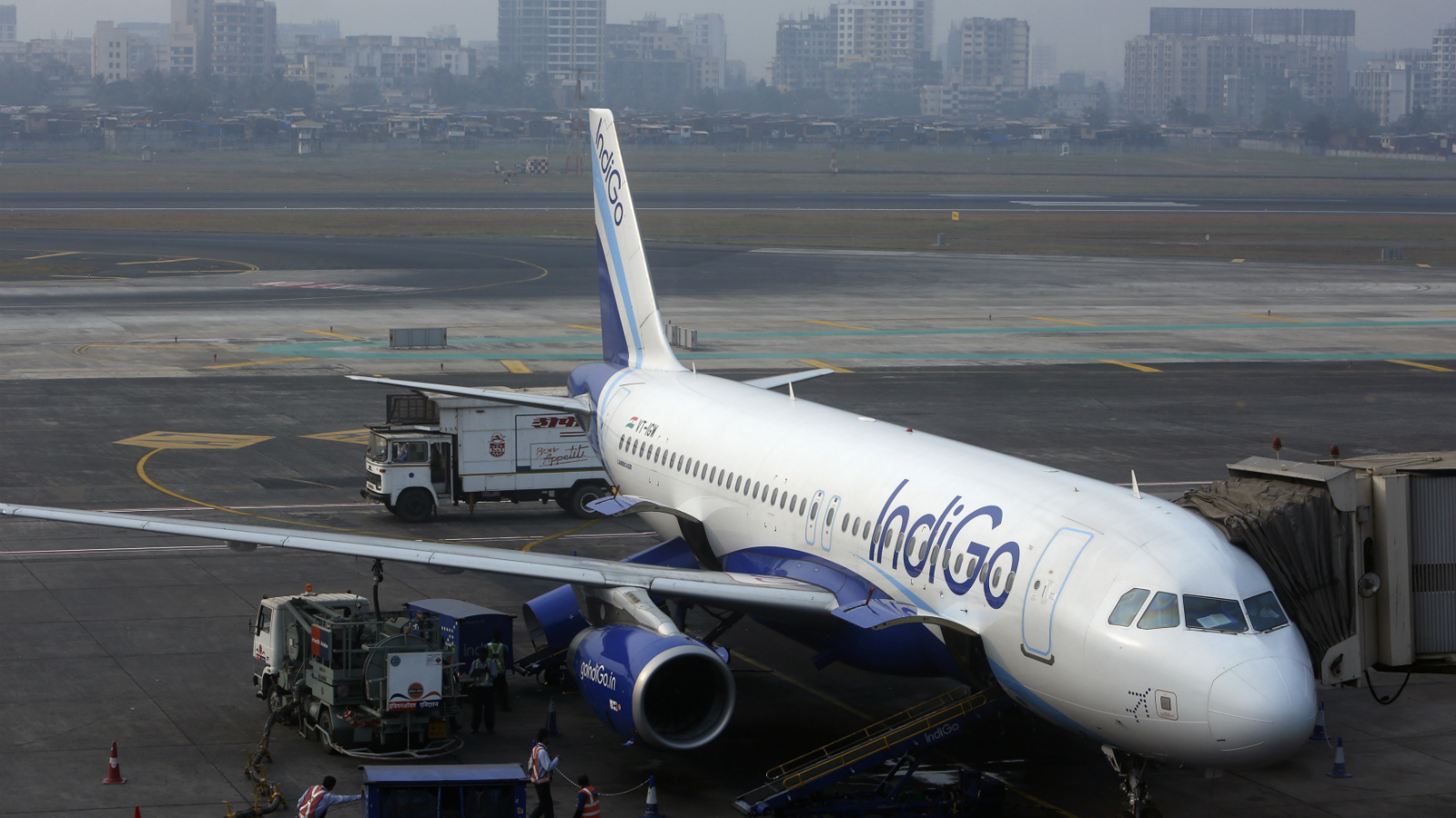 An IndiGo Airlines Airbus A320 aircraft is pictured parked at a gate at Mumbai's Chhatrapathi Shivaji International Airport February 3, 2013.