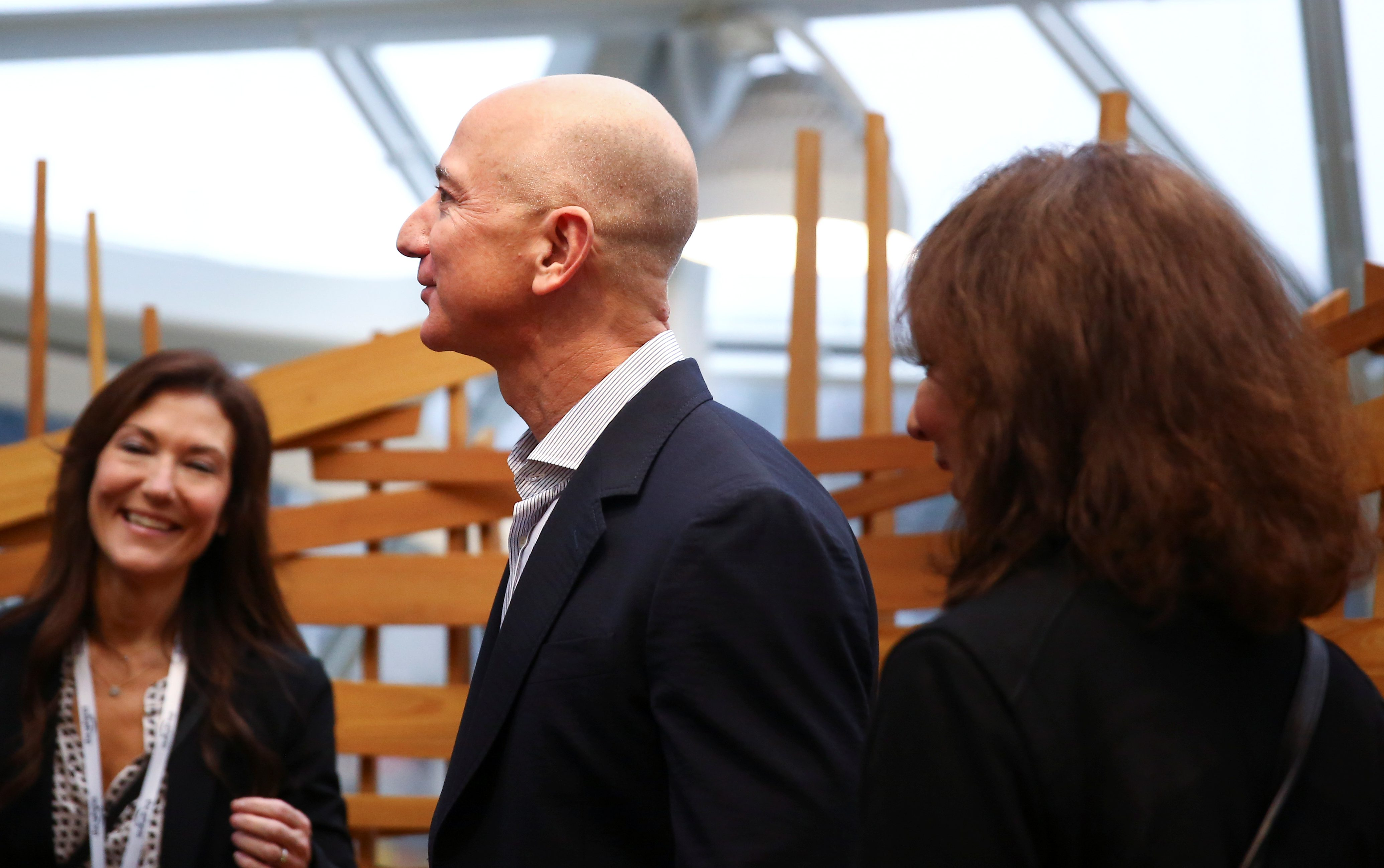 """Amazon founder and CEO Jeff Bezos stands in the """"bird cage"""" structure as he gets a tour of the new Amazon Spheres opening event at Amazon's Seattle headquarters in Seattle, Washington, U.S., January 29, 2018.   REUTERS/Lindsey Wasson - RC1B2FD49C40"""