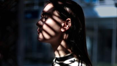 A woman's face in shadows
