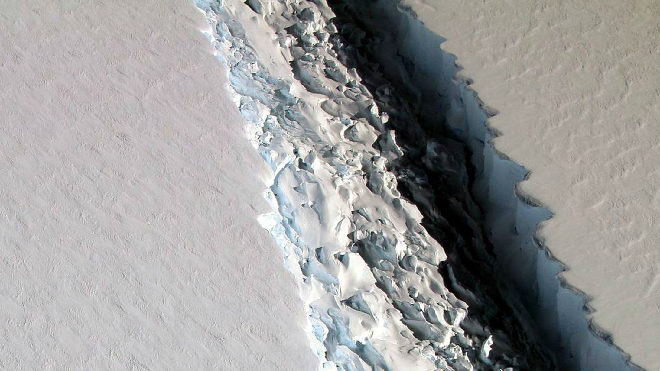 An oblique view of a massive rift in the Antarctic Peninsula's Larsen C ice shelf is shown in this November 10, 2016 photo taken by scientists on NASA's IceBridge mission in Antarctica