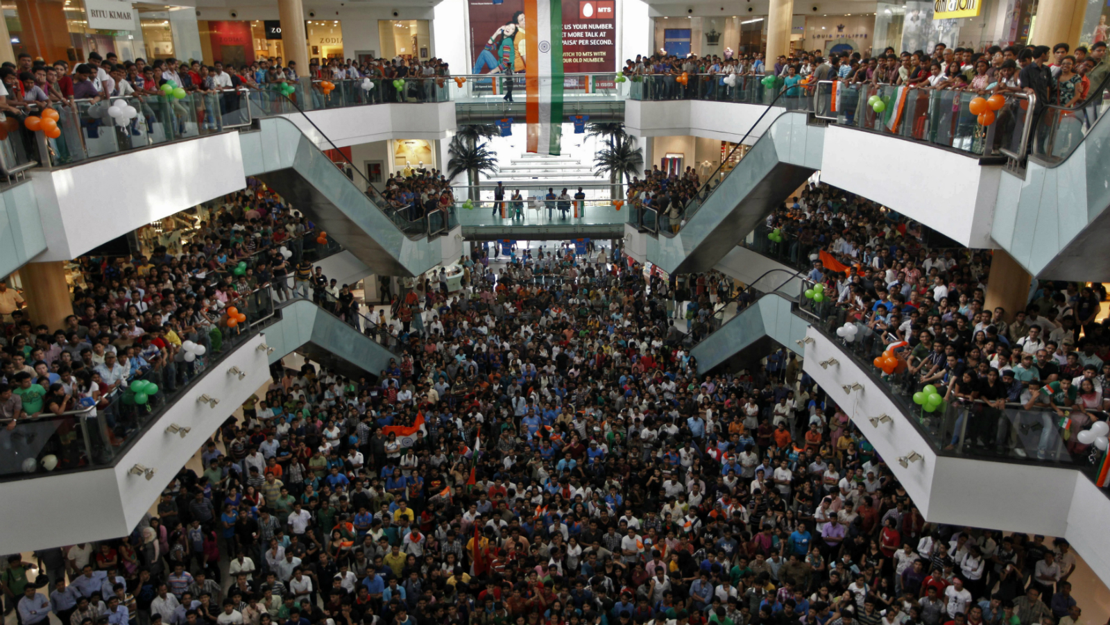 Cricket fans watch the ICC Cricket World Cup final match between India and Sri Lanka, on a big screen inside a shopping mall in Kolkata April 2, 2011.