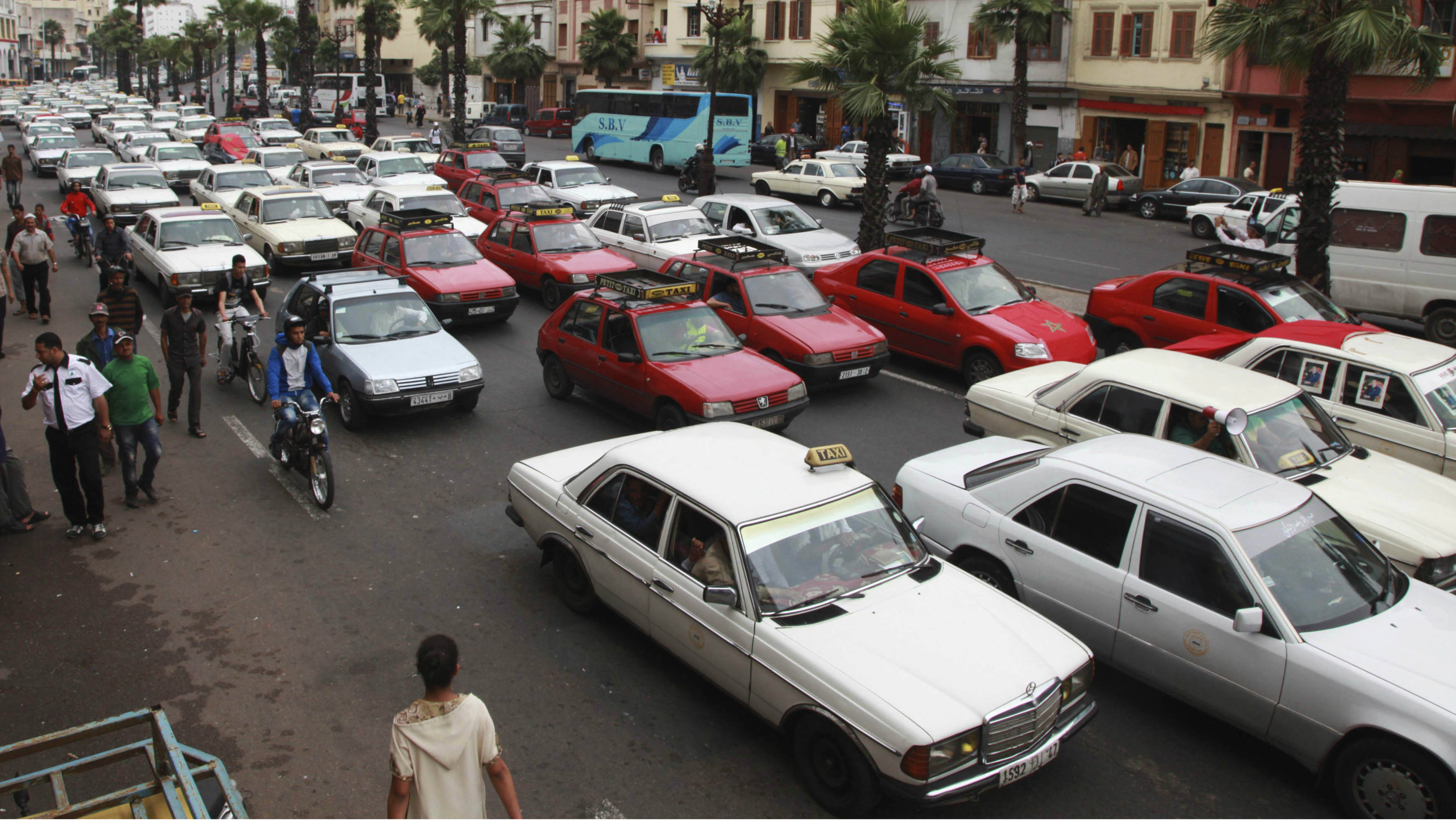 Taxi drivers protesting against a fuel hike bring traffic to a standstill outside the police headquarters in Casablanca's city centre June 11, 2012. Taxi drivers protested on Monday against a hike in fuel prices implemented by Moroccan Prime Minister Abdelilah Benkirane's government.