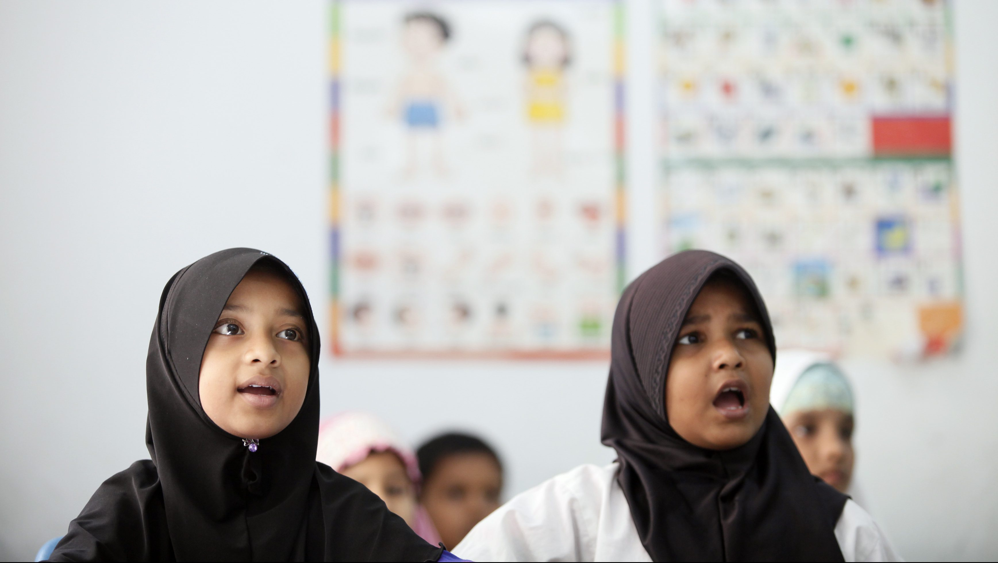 Young Myanmar refugees from the Rohingya ethnic minority attend their English class in Kuala Lumpur in this August 16, 2011 file picture. In 1982 Myanmar passed a law which made it impossible for Rohingyas to get full citizenship. Many fled to Bangladesh in 1991 and 1992 following a government crackdown. Today, an estimated 800,000 live in Myanmar and up to 300,000 in Bangladesh. On August 25, 2011, the U.N. refugee agency UNHCR will launch an international campaign to highlight the plight of the estimated 12-15 million people worldwide who are not recognised as nationals by any country and become stateless. Picture taken August 16, 2011. To match STATELESS/ REUTERS/Bazuki Muhammad (MALAYSIA - Tags: SOCIETY POLITICS) - GF2E78N0N4X02