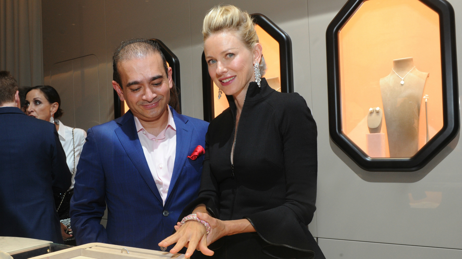 Actress Naomi Watts and luxury jeweler Nirav Modi, left, celebrate the launch of the first Nirav Modi boutique in the U.S. on Tuesday, Sept. 8, 2015, in New York.