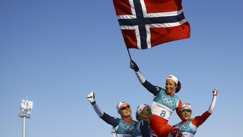 Winner Marit Bjoergen of Norway waves the Norwegian flag at Pyeongchang 2018 Winter Olympics