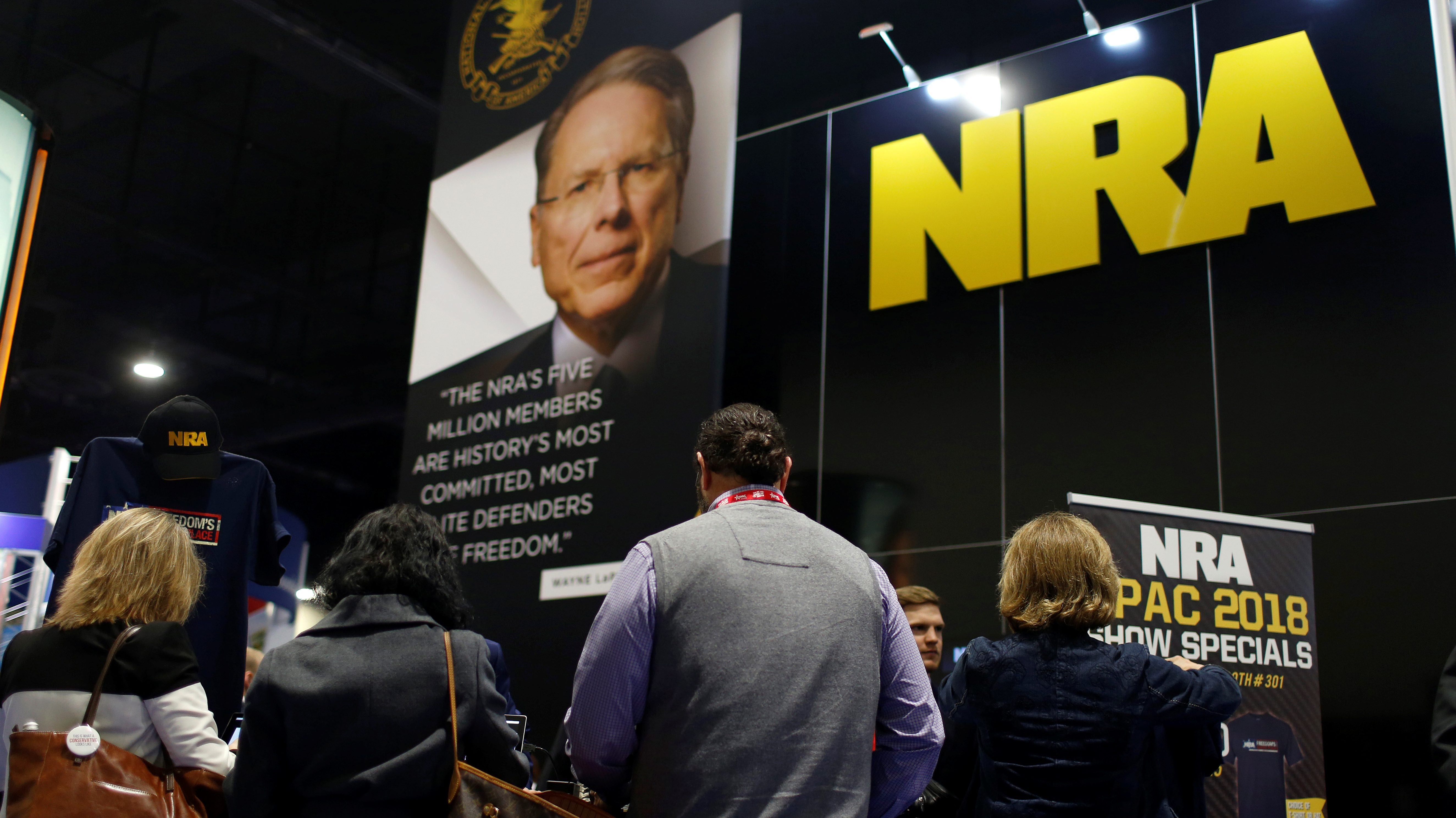 People sign up at the booth for the National Rifle Association (NRA) at the Conservative Political Action Conference (CPAC) at National Harbor, Maryland, U.S., February 23, 2018.      REUTERS/Joshua Roberts - RC1C9A3D0940