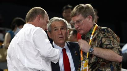 U.S. President George W. Bush and Russia's Prime Minister Vladimir Putin (L) attend the opening ceremony of the Beijing 2008 Olympic Games at the National Stadium, August 8, 2008. The stadium is also known as the Bird's Nest.
