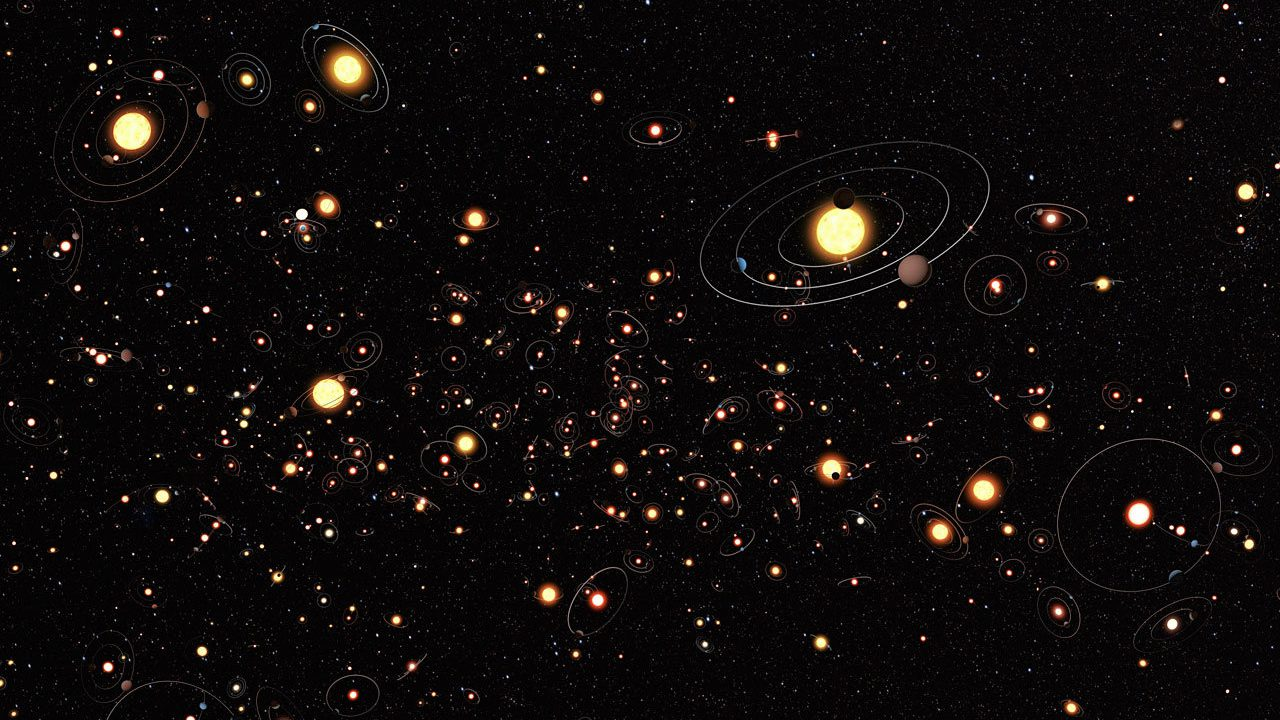 This artist's cartoon view gives an impression of how common planets are around the stars in the Milky Way. The planets, their orbits and their host stars are all vastly magnified compared to their real separations. A six-year search that surveyed millions of stars using the microlensing technique concluded that planets around stars are the rule rather than the exception. The average number of planets per star is greater than one.