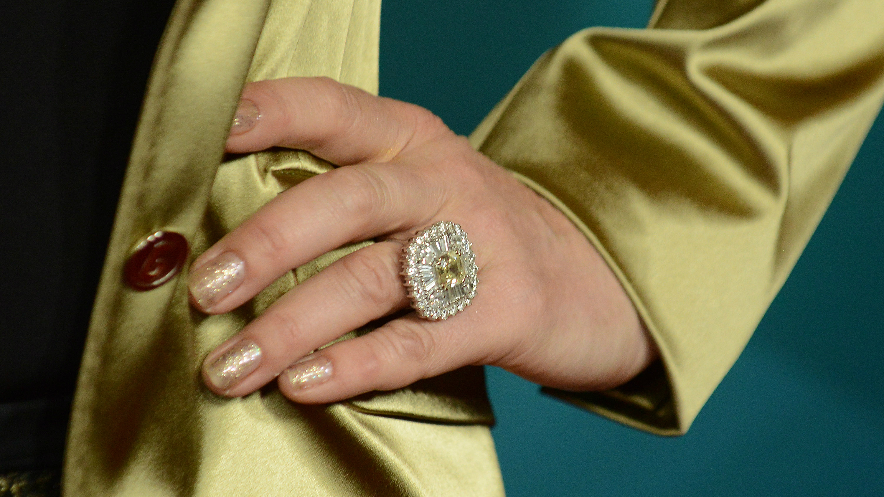 A woman wearing a gold ring.