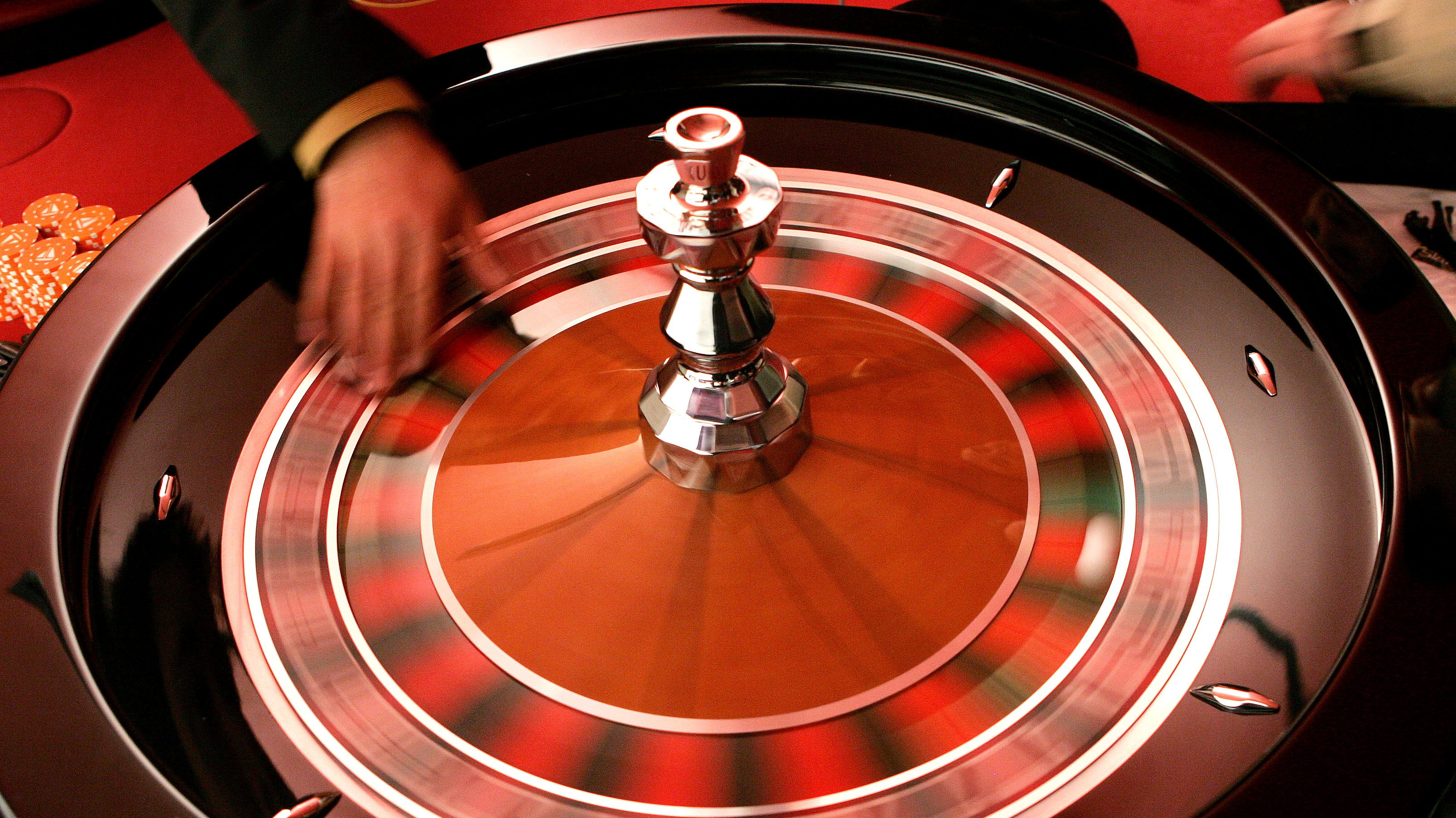 Croupier turns the roulette at the Brussels Casino