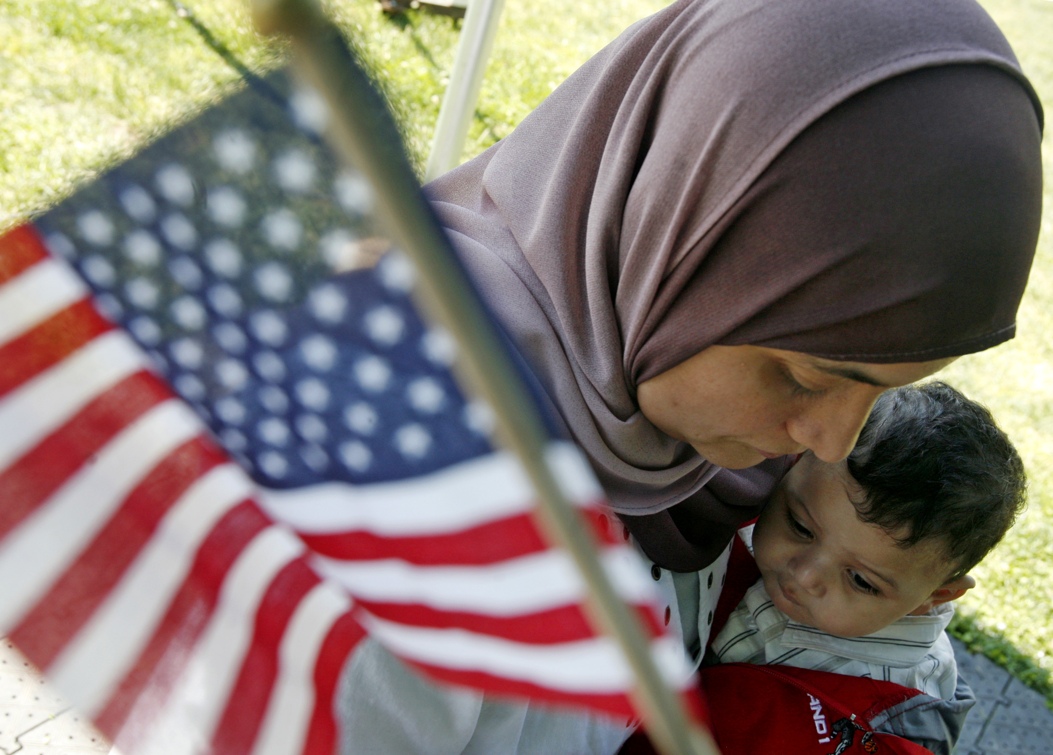 Mezry of Morocco hugs her son after taking the oath of citizenship in Mount Vernon