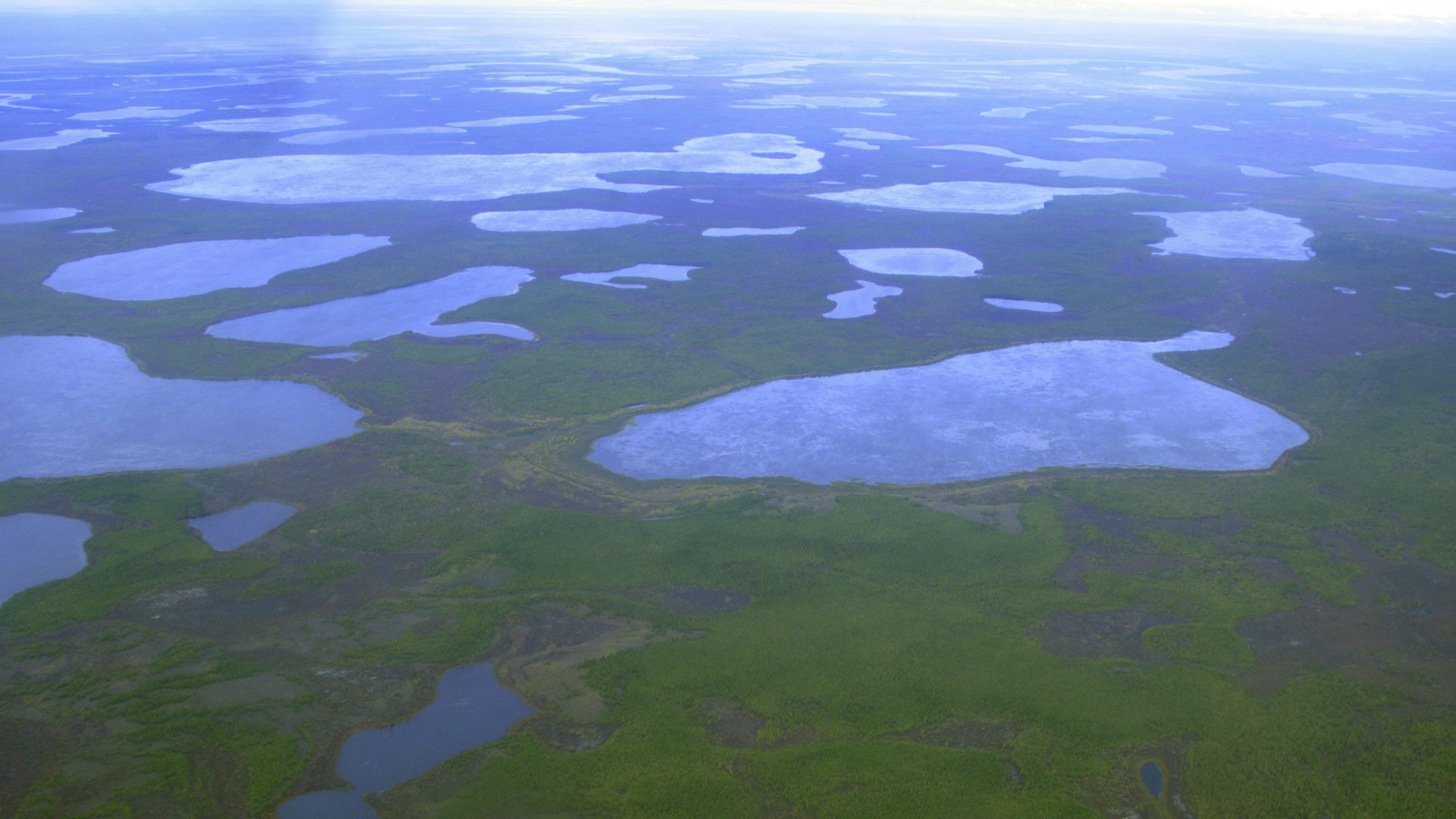 """As the permafrost thaws, it often forms """"lakes"""" of meltwater, which accelerate the thawing further. Now we know there is lots of mercury in there too."""