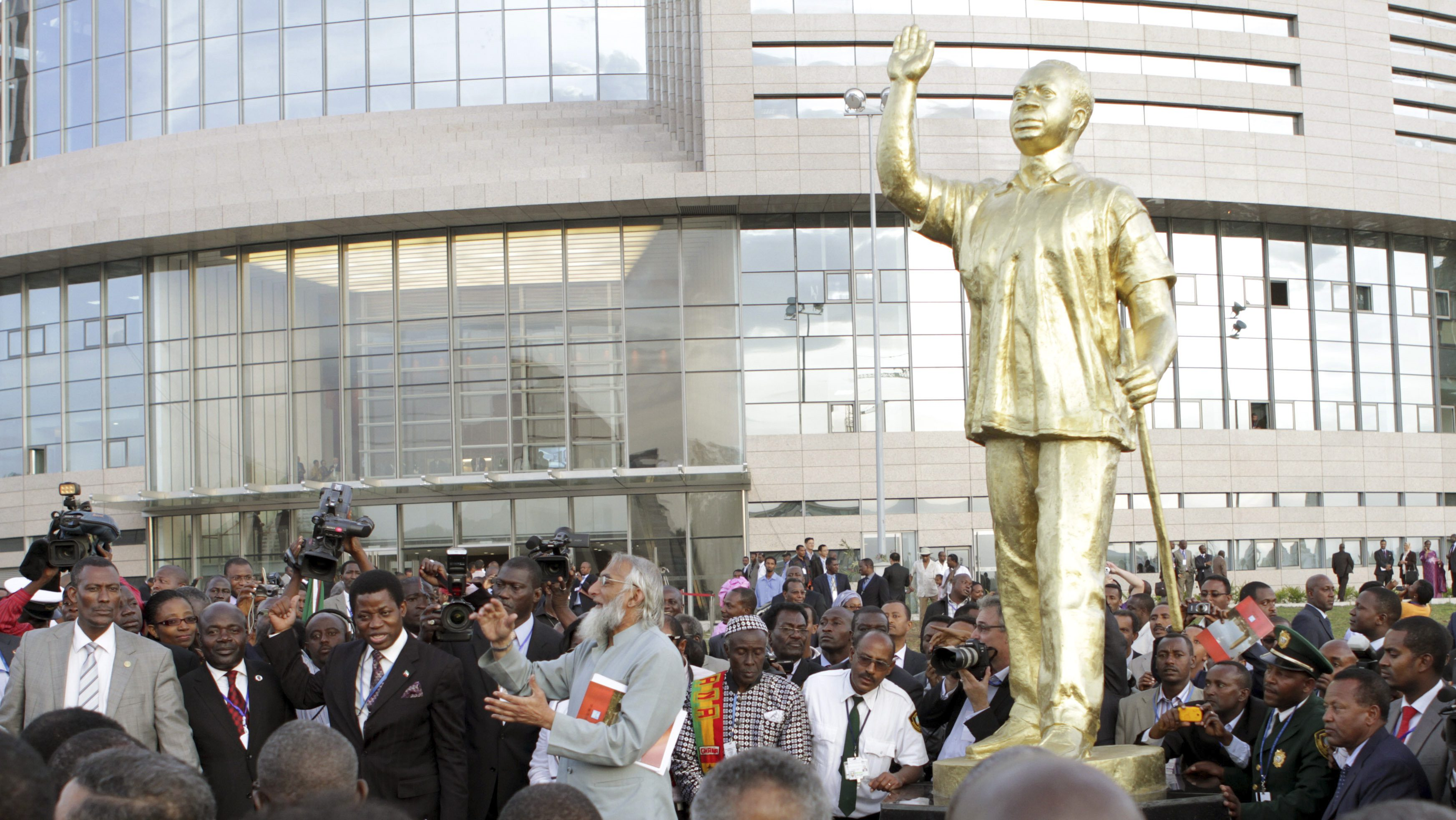 Dignitaries and delegates mill around a statue of Ghana's late leader Kwame Nkrumah at the opening of the new African Union headquarters in Ethiopia's capital Addis Ababa January 28, 2012.