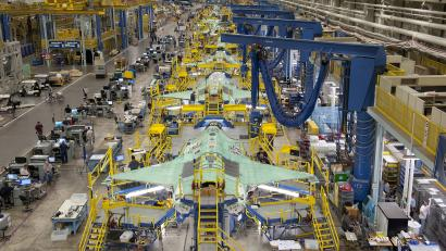 Workers can be seen on the moving line and forward fuselage assembly areas for the F-35 Joint Strike Fighter at Lockheed Martin Corp's factory located in Fort Worth, Texas in this October 13, 2011 handout photo provided by Lockheed Martin. Lockheed Martin Corp on February 25, 2013 said there was no evidence that a lithium-ion battery contributed to a Feb. 14 incident that caused smoke in the cockpit of an F-35 test plane. Lockheed spokesman Michael Rein said initial reviews indicated a potential failure in the plane's cooling system, which had been removed from the aircraft for further study. Picture taken October 13, 2011.