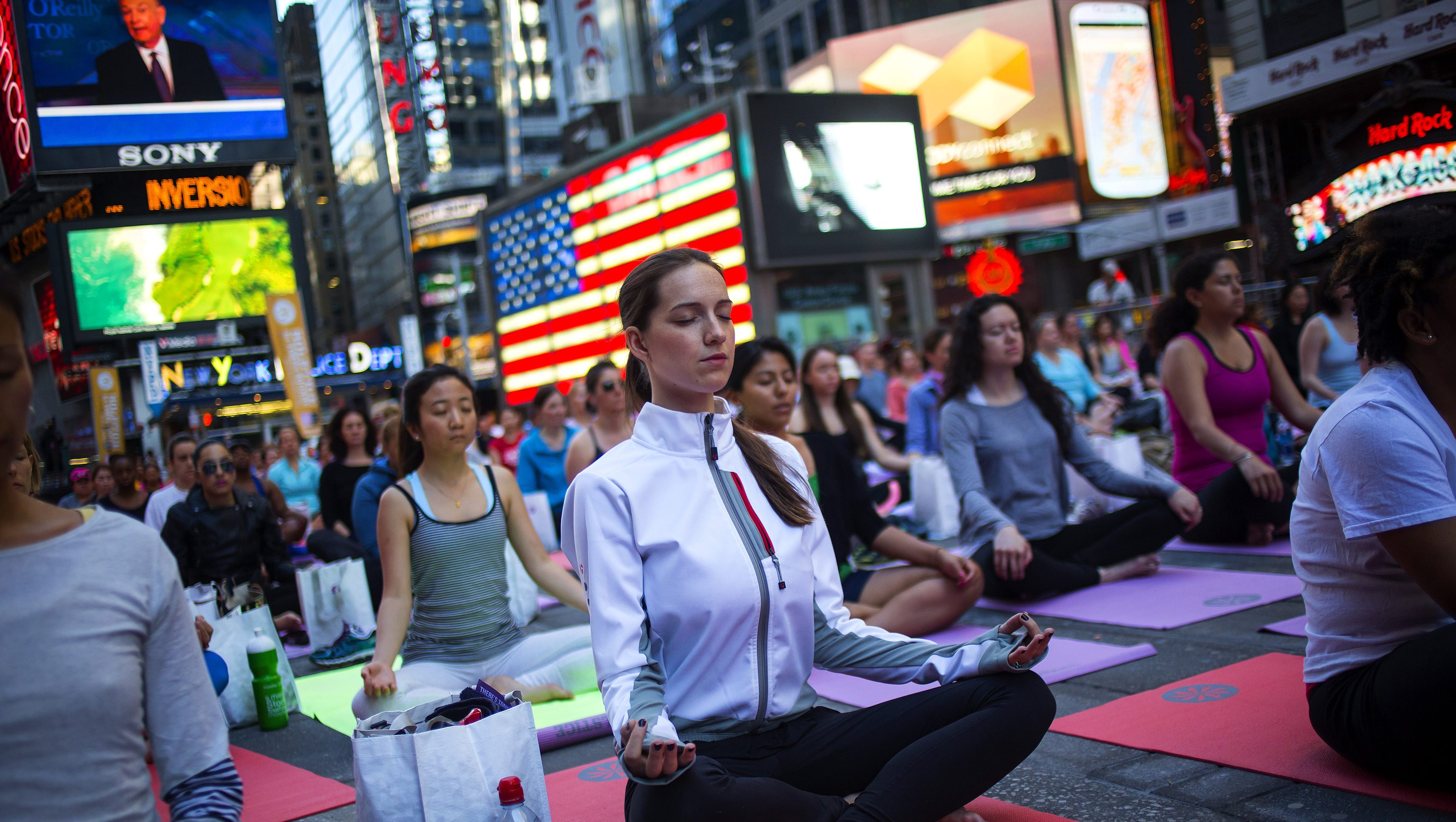 People practice yoga in Times Square as part of a Summer Solstice celebration in New York June 21, 2014.