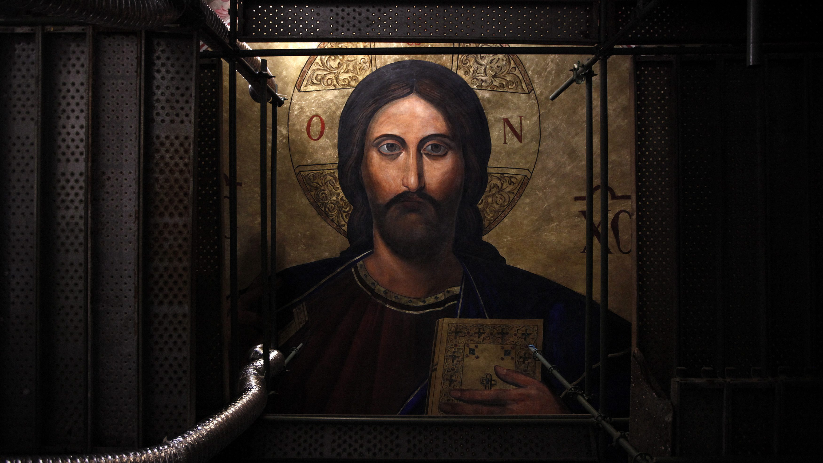 A restored fresco of Jesus Christ is seen at the main cupola of the Orthodox Metropolitan Cathedral of Athens June 24, 2014. The church, built in 1862, is undergoing a major artistic restoration since April and is expected to be completed by the end of 2015.