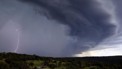 Lightning can be seen as a large storm front crosses over the Sydney suburb of Wakehurst December 5, 2014.