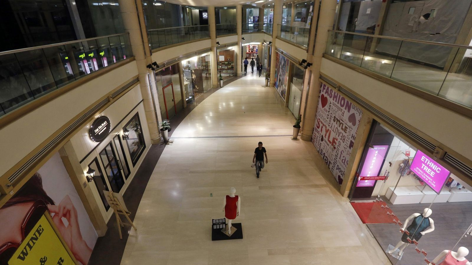 A man walks inside a MGF Metropolitan mall in New Delhi February 23, 2015. A severe shortage of attractive malls has made setting up shop in India easier said than done, crimping expansion plans for both foreign retailers such as Lacoste and domestic giants like department store chain Shoppers Stop. India's searing heat, heavy traffic and cluttered pavements make malls the most popular option for urban middle class consumers looking for a day out. But many centres - despite having been built in the last decade - are struggling to draw shoppers or retailers because of poor design or because they are difficult to manage. Picture taken February 23, 2015.    REUTERS/Adnan Abidi (INDIA - Tags: BUSINESS) - GM1EB2O051F01