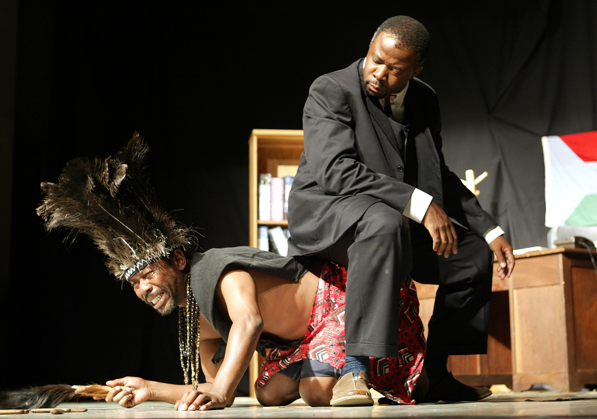 "Zimbabwean actors Daves Guzha (R) and Mackeys Tickeys in a scene from a 2004 local satirical comedy production called ""Super Patriots and Morons"", which dramatises life in an unnamed African country under an iron-fisted dictator. The Censorship Board under Mugabe has banned the play."