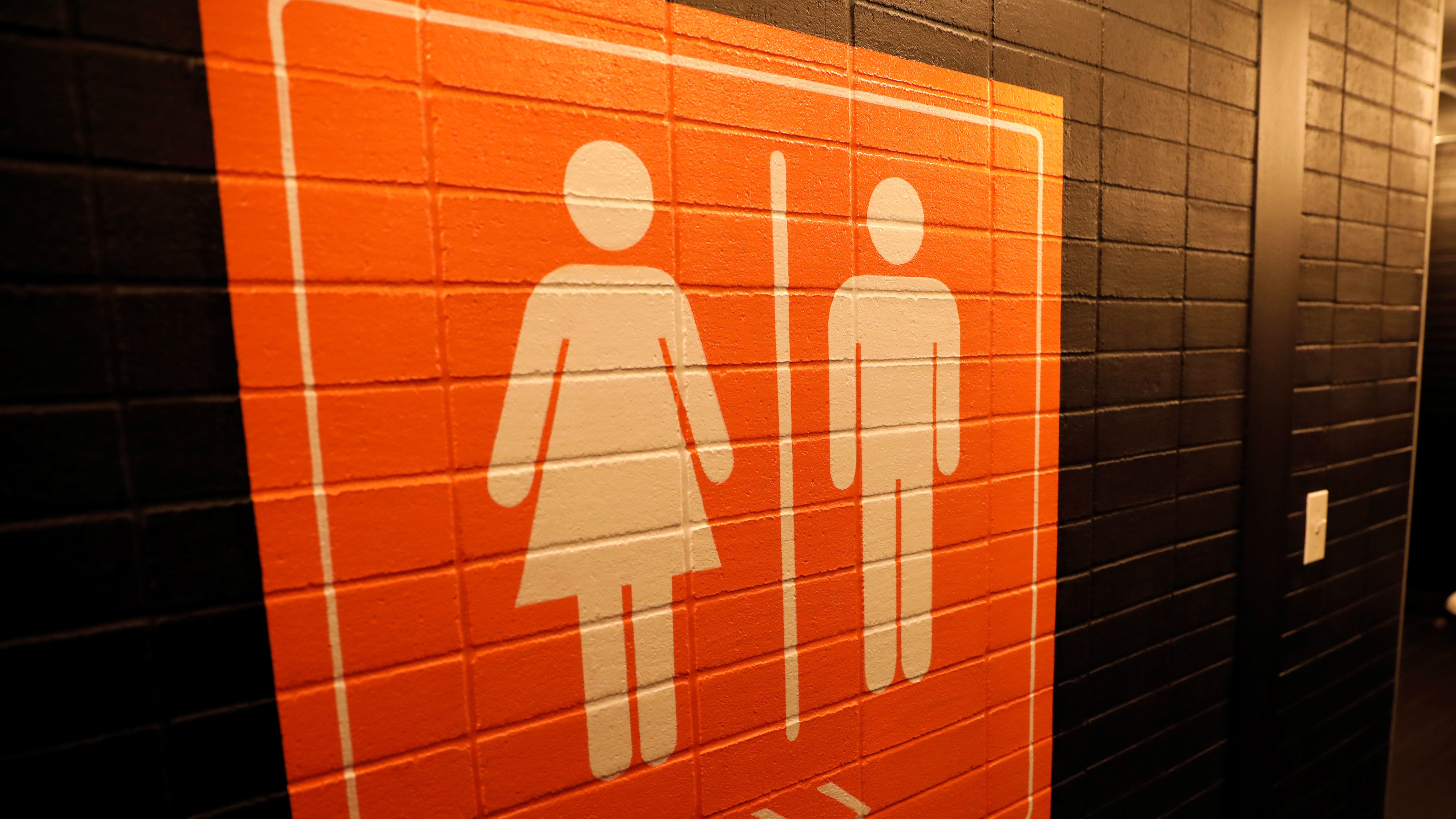 A sign is seen pointing to a gender neutral restroom in New York City