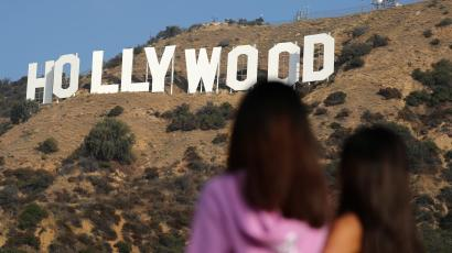 Women look at the Hollywood sign in Hollywood