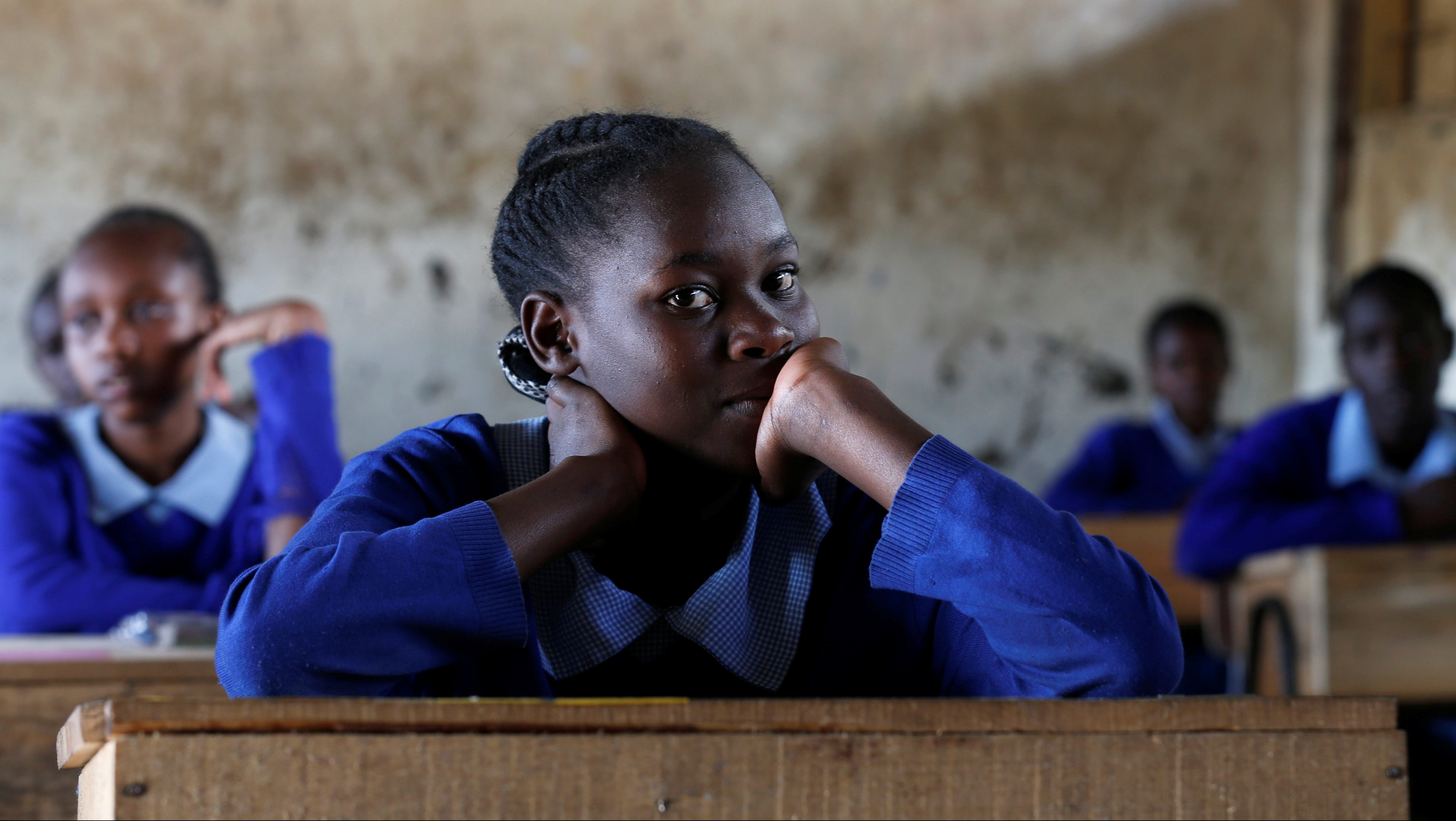 A pupil sits inside a classroom ahead of the primary school final national examinations at Kiboro Primary school along Juja road in Nairobi