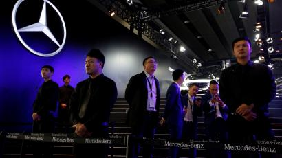 Security guards stand in front of Mercedes Benz booth at Auto Guangzhou in Guangzhou