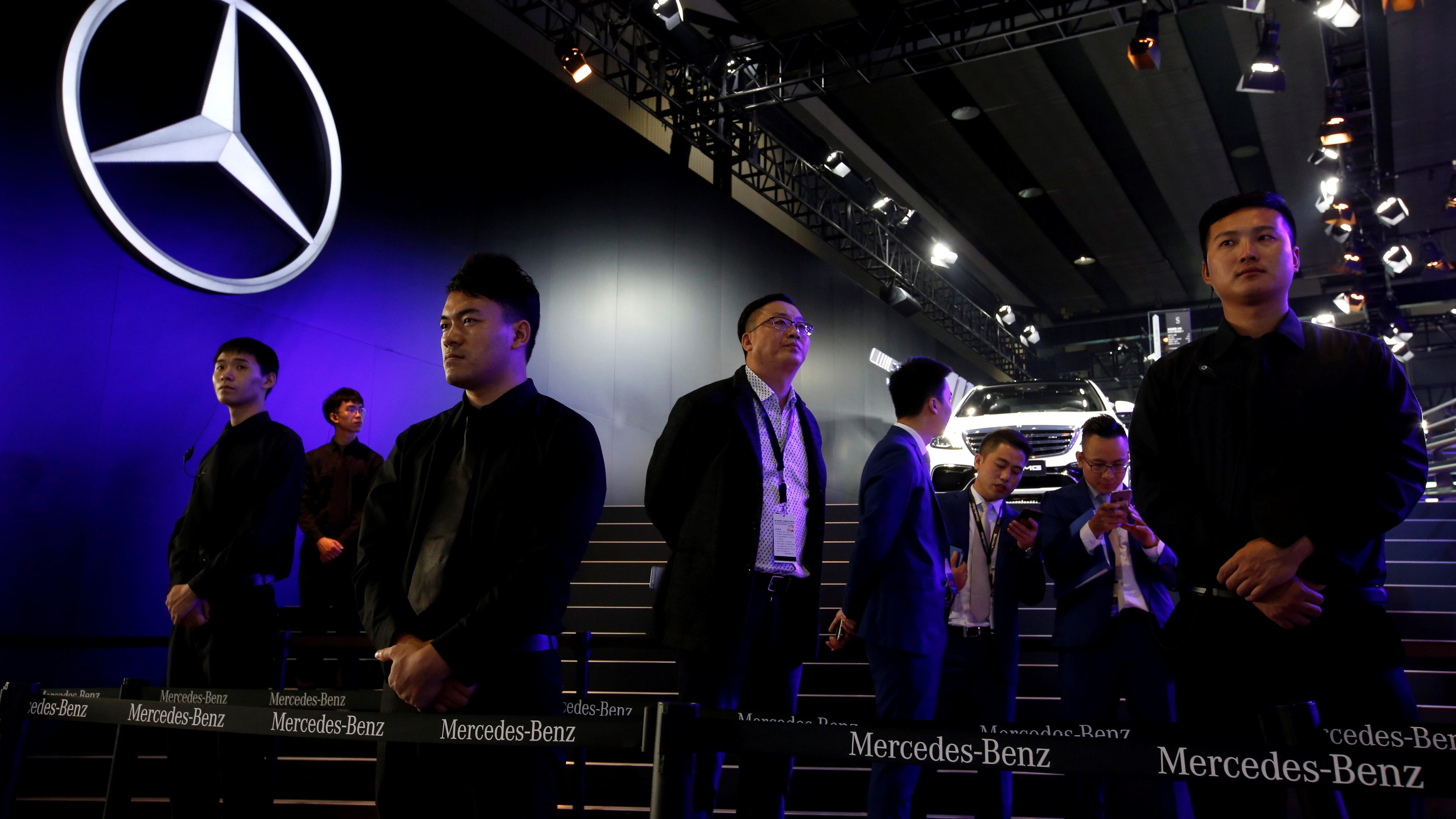 Security guards stand in front of Mercedes Benz booth at Auto Guangzhou in Guangzhou, China November 17, 2017.      REUTERS/Bobby Yip - RC1327DBA800