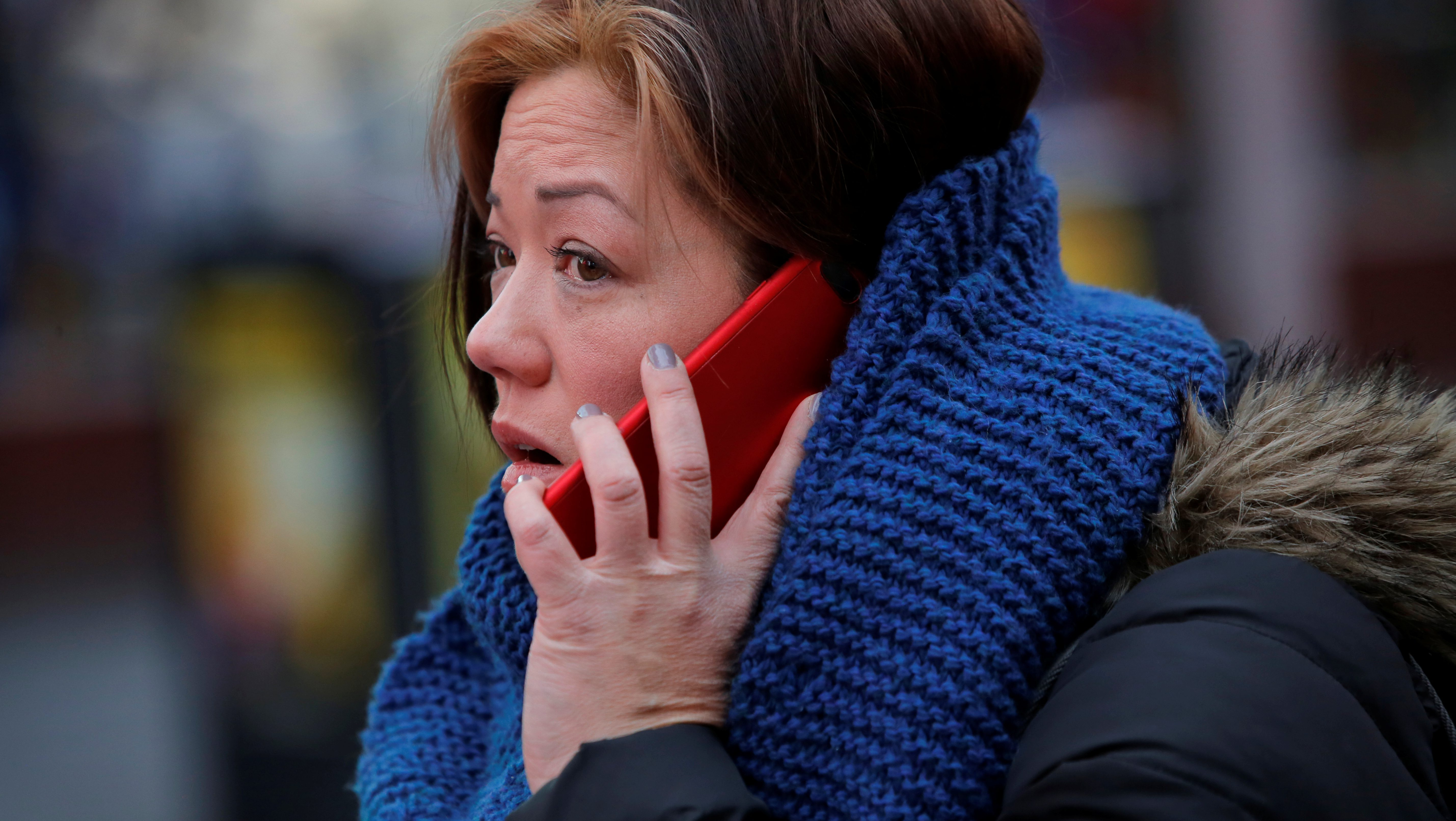 A woman uses her cell phone in Manhattan, New York
