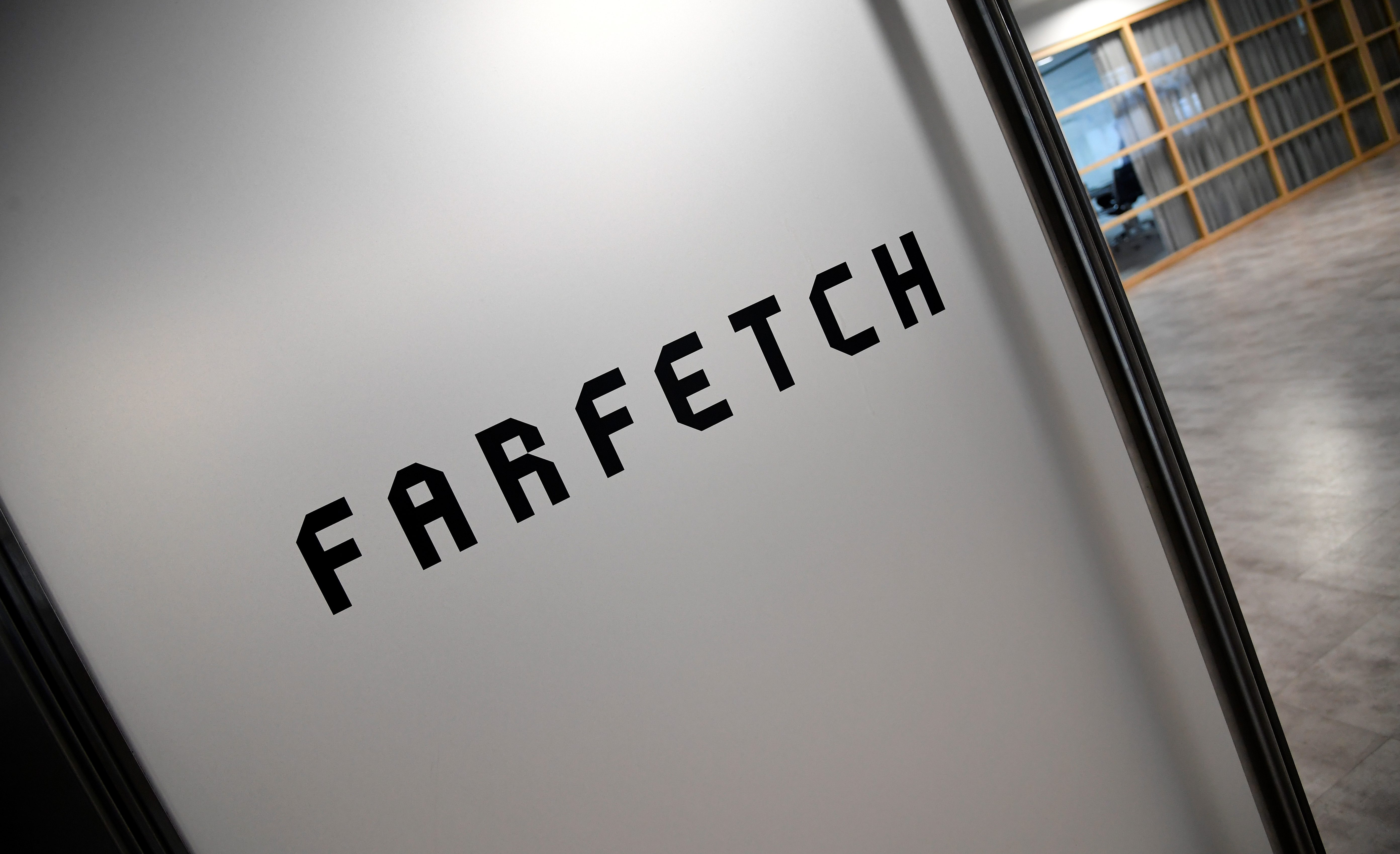Branding for online fashion house Farfetch is seen at the company headquarters in London, Britain January 31, 2018. REUTERS/Toby Melville - RC1E8E0D9F80