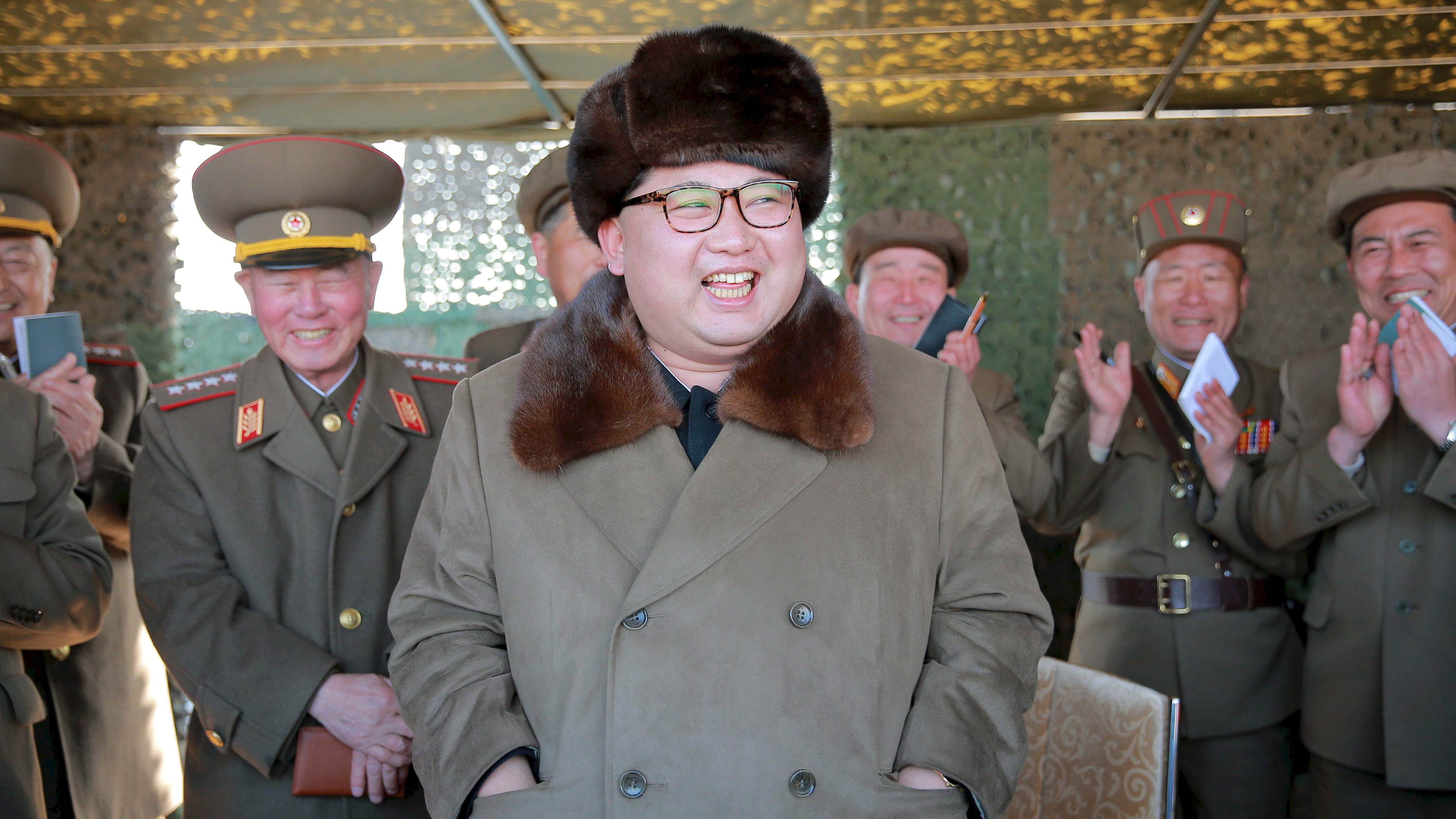 North Korean leader Kim Jong Un attends a demonstration of a new large-caliber multiple rocket launching system at an unknown location, in this undated file photo released by North Korea's Korean Central News Agency (KCNA) on March 22, 2016.