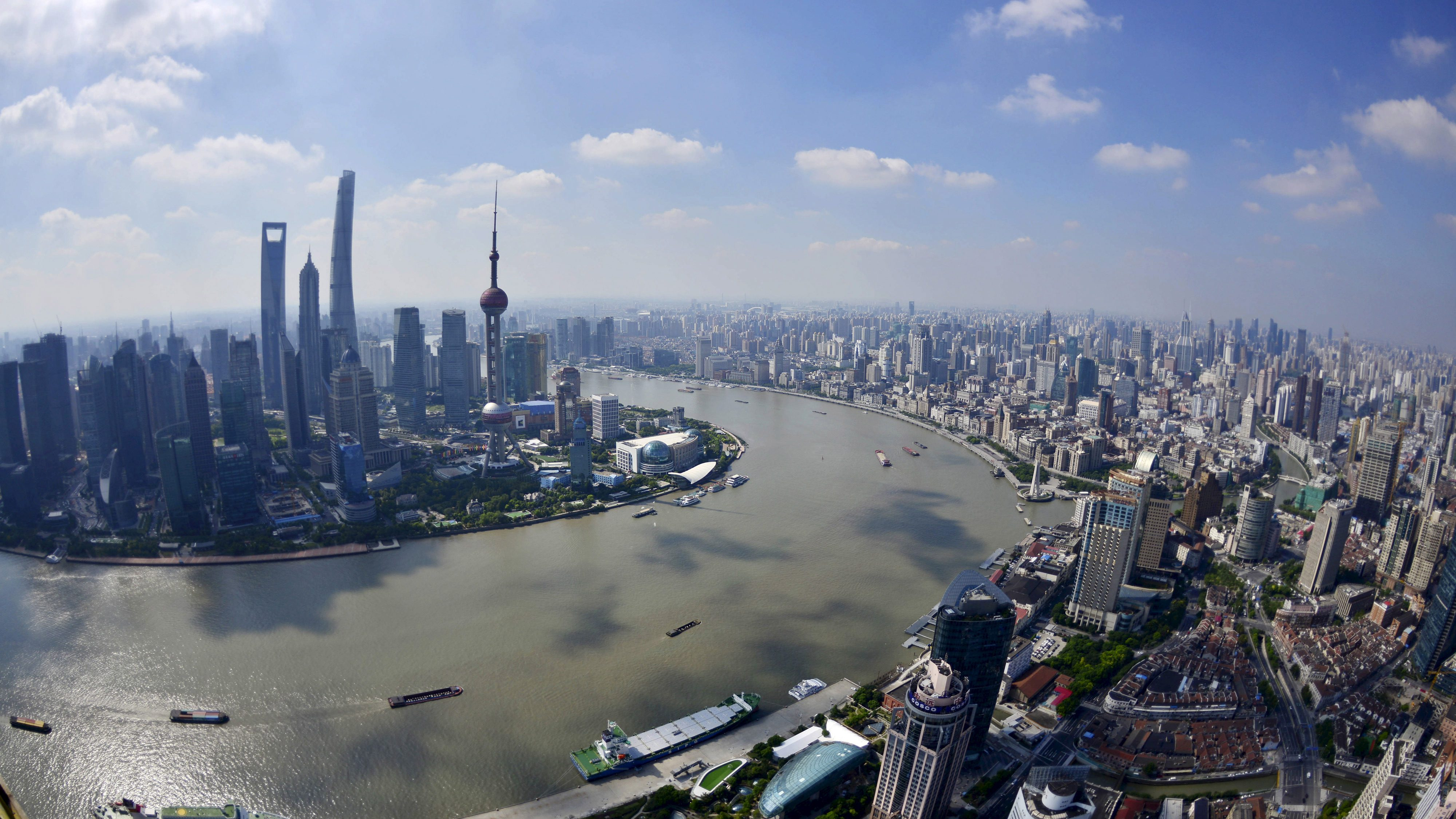 A general view shows the Shanghai city skyline on a sunny day in Shanghai, China, September 11, 2015.  CHINA OUT. NO COMMERCIAL OR EDITORIAL SALES IN CHINA  - GF10000201319