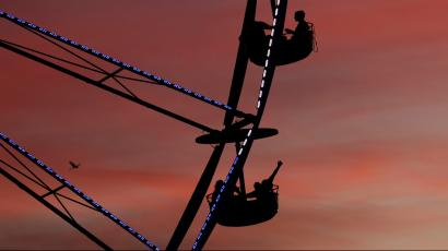 People ride a ferris wheel at sunset during Desert Trip music festival at Empire Polo Club in Indio