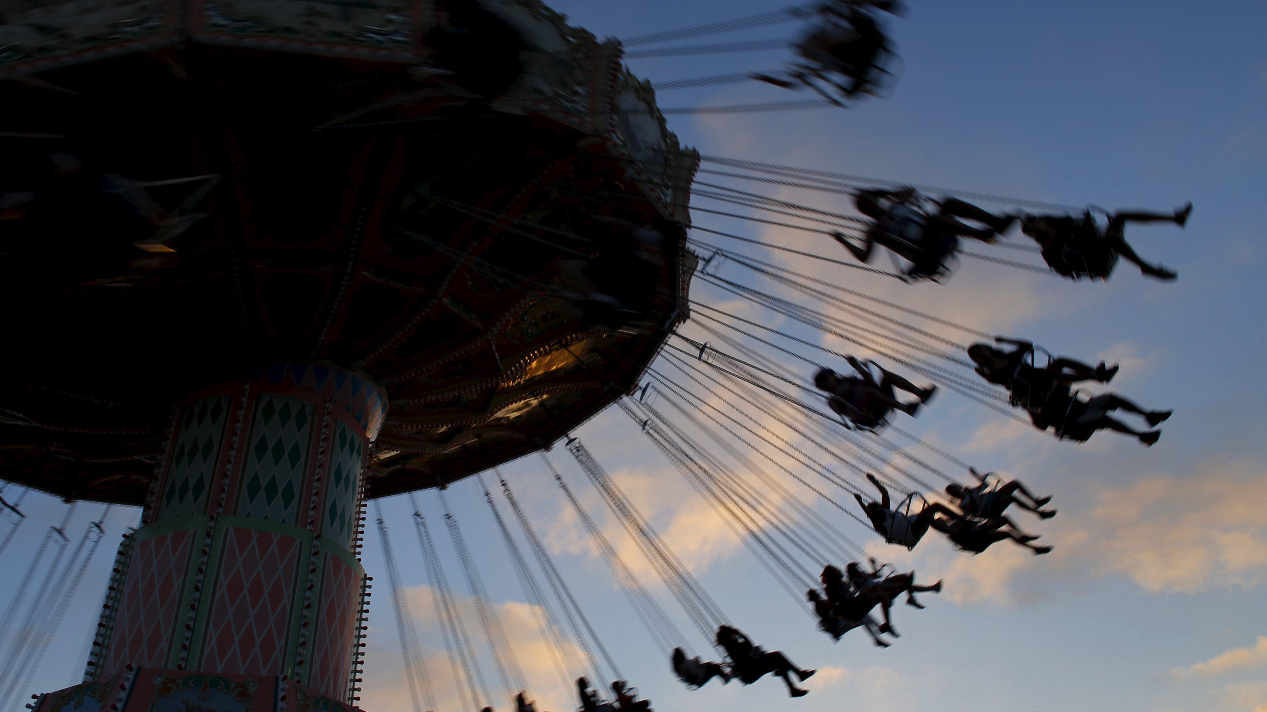 Fair-goers enjoy a ride as the sun sets at the annual San Diego County Fair in Del Mar, California