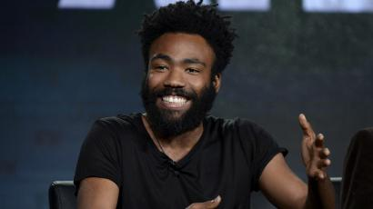 Donald Glover smiles on stage
