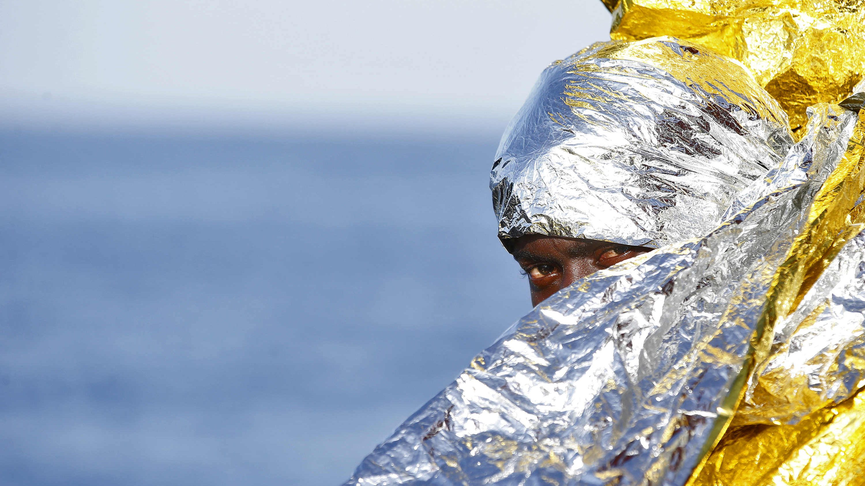 A migrant waits to disembark from the rescue vessel Responder
