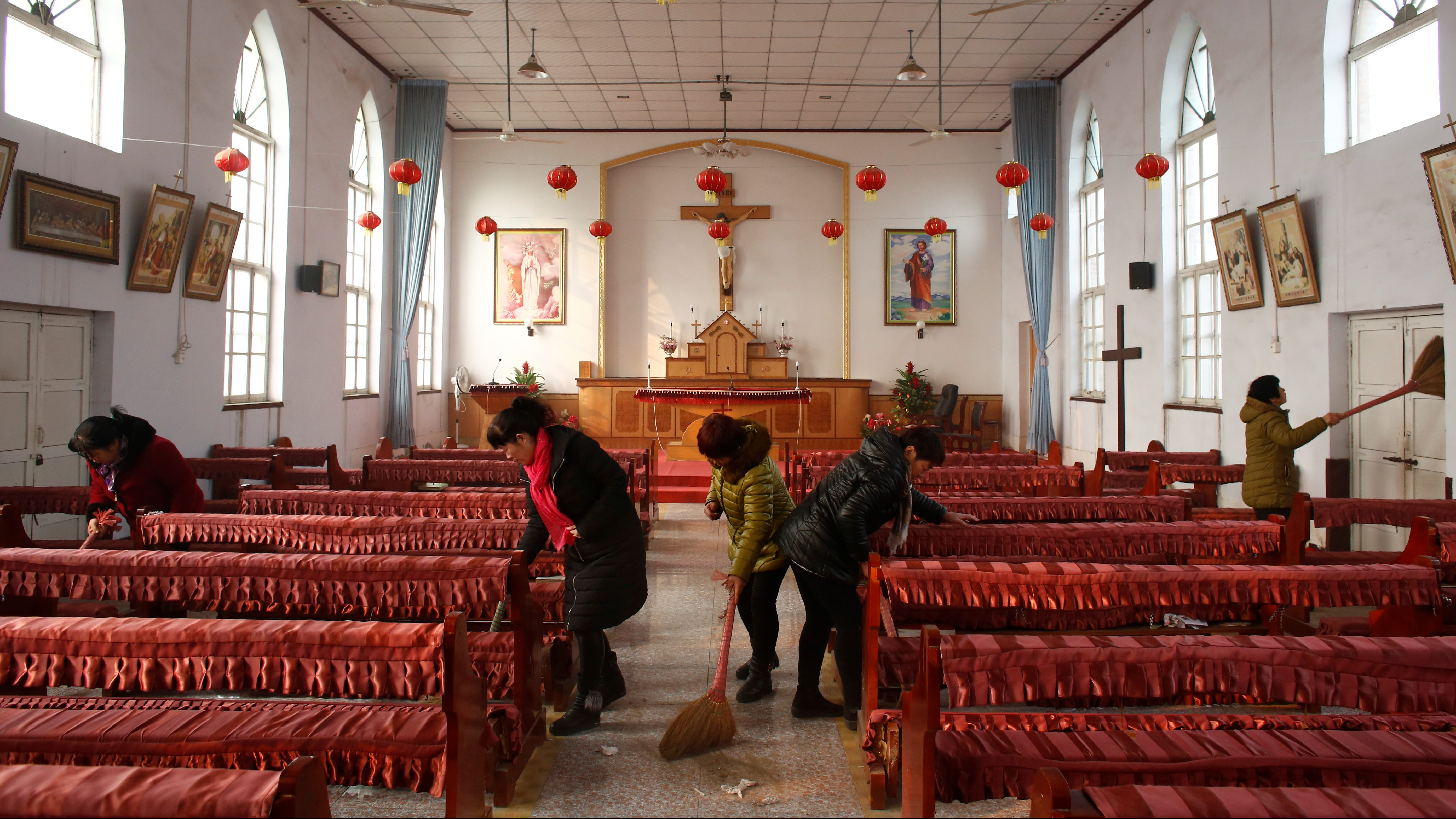 Members of the congregation clean the unofficial Catholic church after Sunday service in Majhuang village, Hebei Province, China, December 11, 2016. Picture taken December 11, 2016.