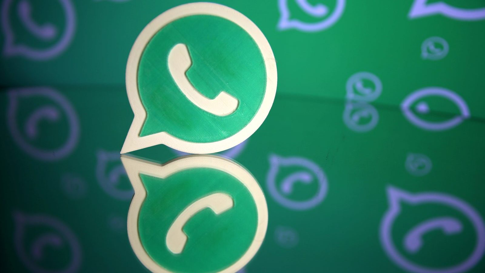 A 3D printed Whatsapp logo is seen in front of a displayed Whatsapp logo in this illustration September 14, 2017. REUTERS/Dado Ruvic - RC16FAE1EA70