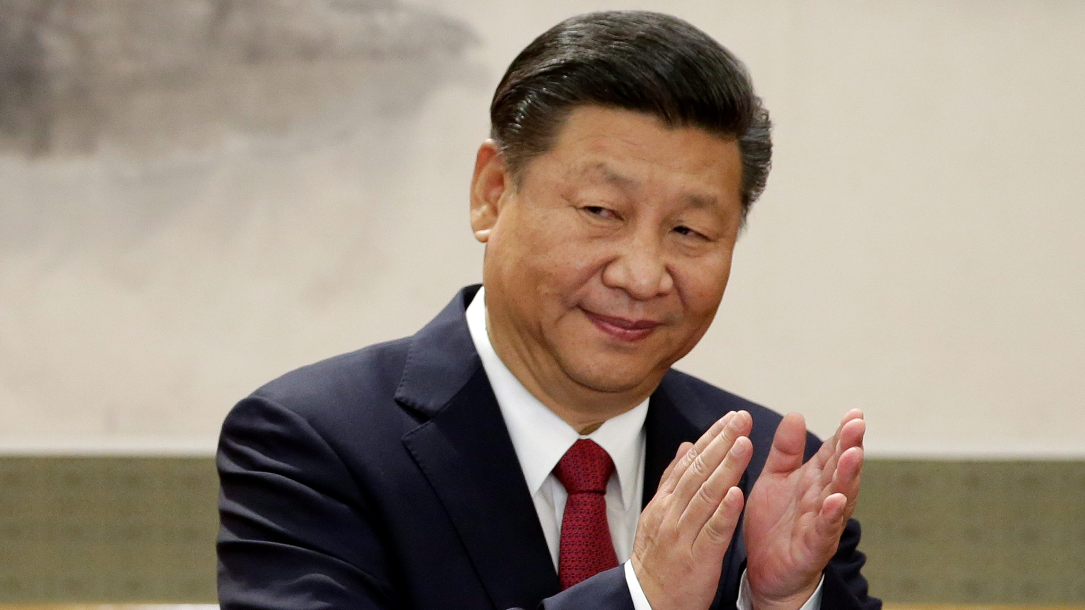 China's President Xi Jinping claps after his speech as he and other new Politburo Standing Committee members meet with the press at the Great Hall of the People in Beijing, China October 25, 2017.