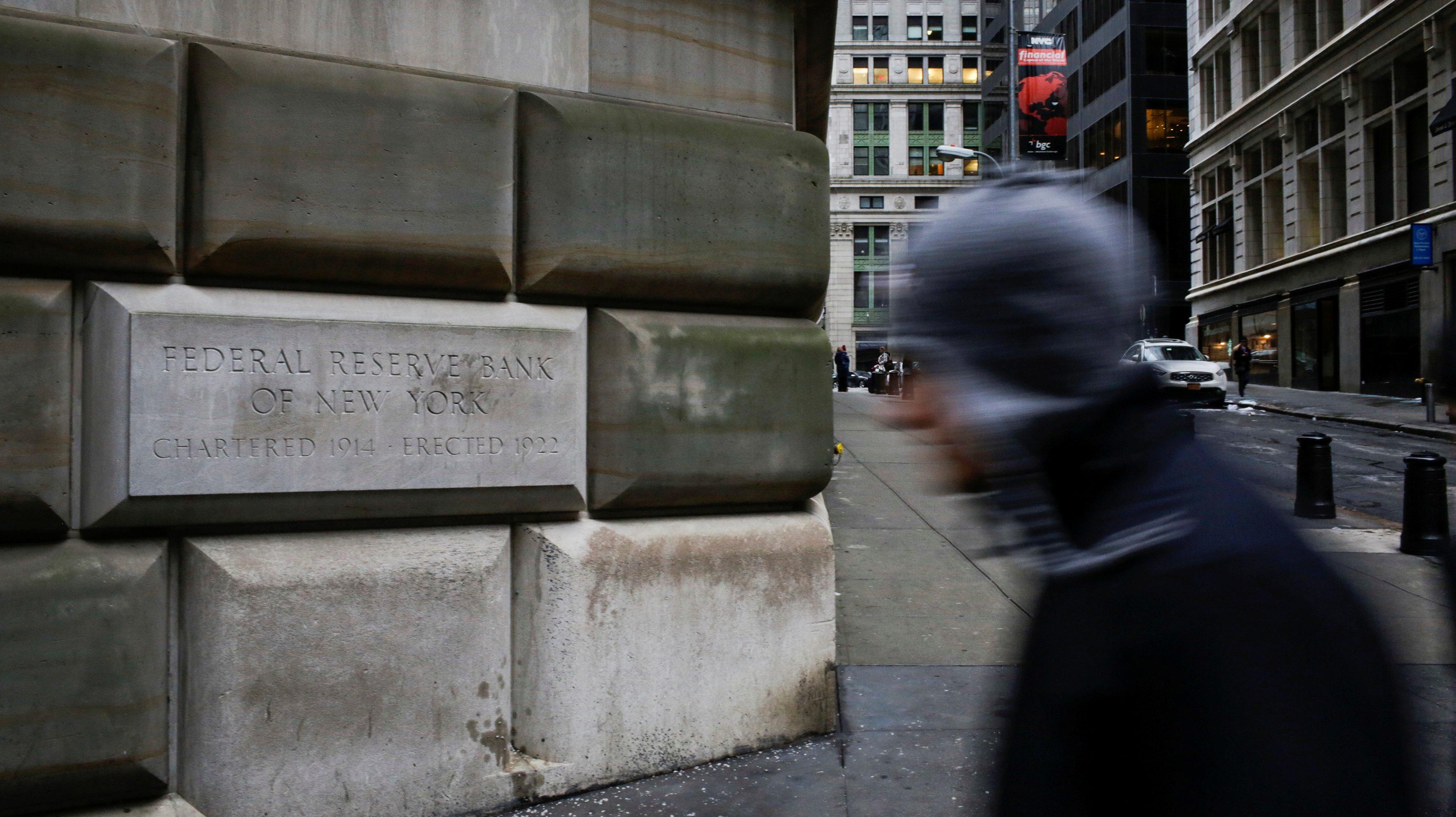 A man walks next to the Federal Reserve Bank of New York in the Manhattan borough of New York, U.S., December 16, 2017.  REUTERS/Eduardo Munoz - RC1EEF8123B0