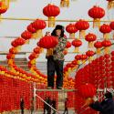 Workers install red lanterns ahead of the Chinese Lunar New Year, or Spring festival, at a tourist attraction in Linyi, Shandong province, China January 31, 2018. Picture taken January 31, 2018.