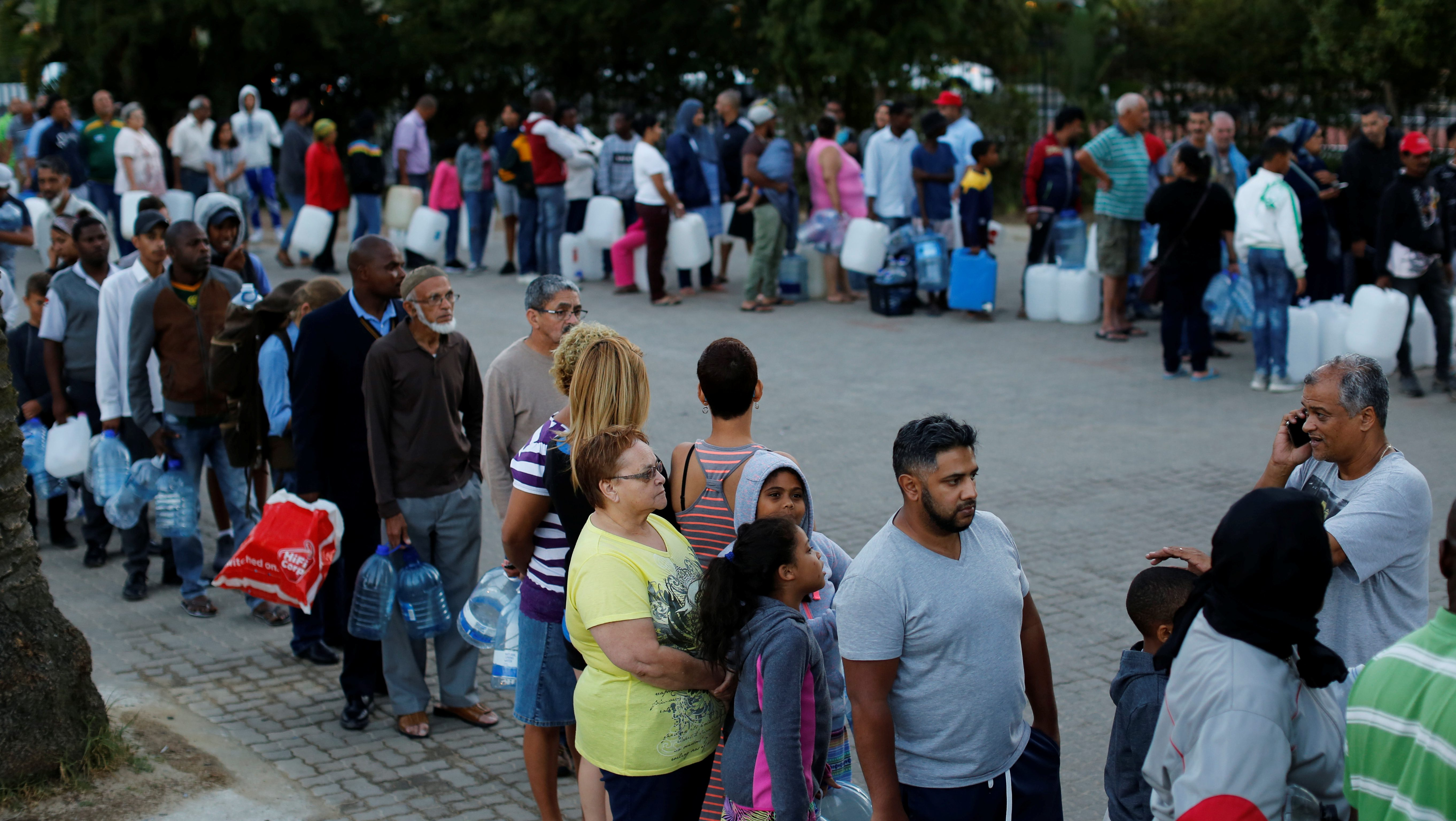 People queue to collect water as fears over the city's water crisis grow in Cape Town