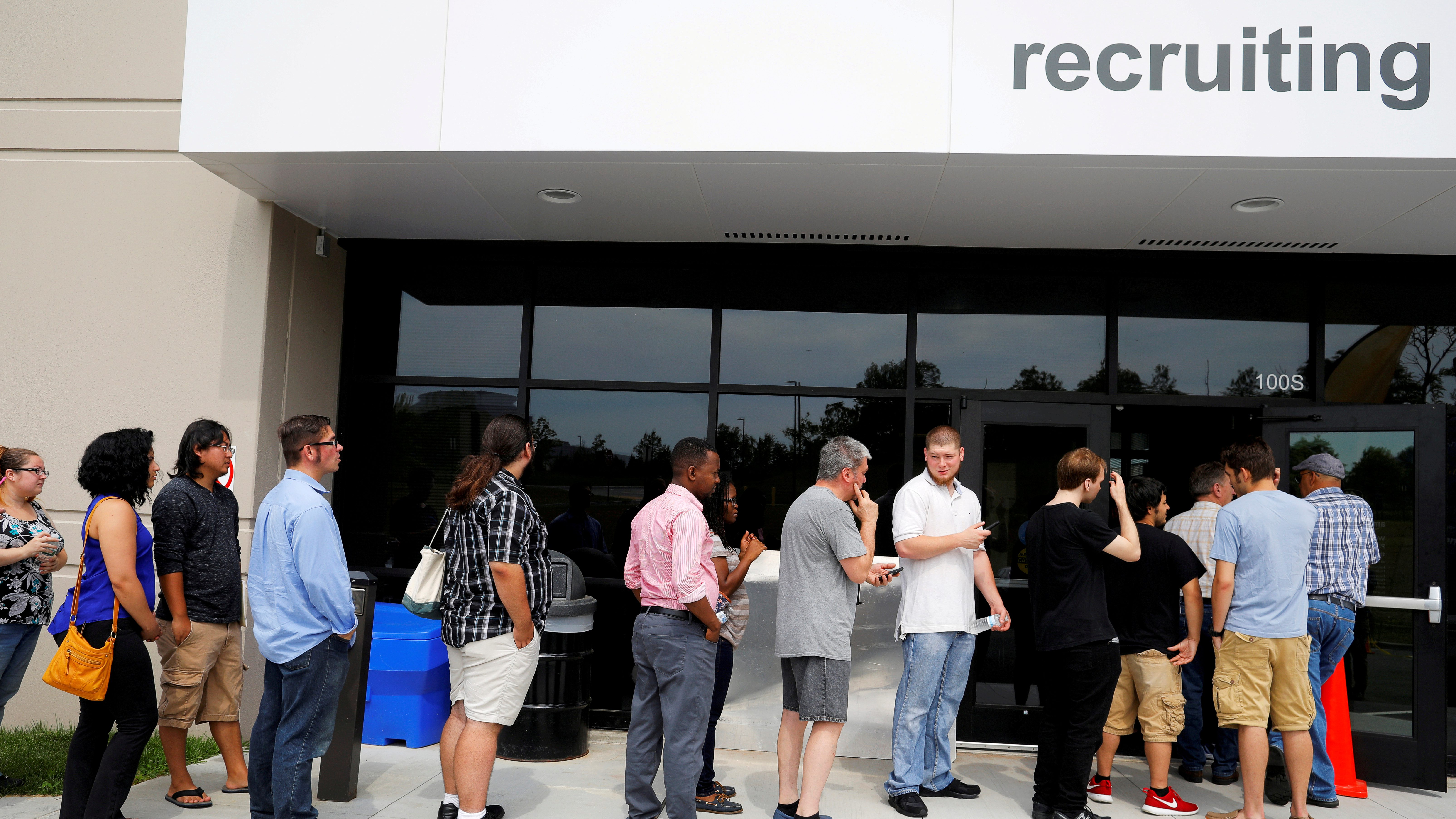 "Job seekers line up to apply for jobs during ""Amazon Jobs Day."""